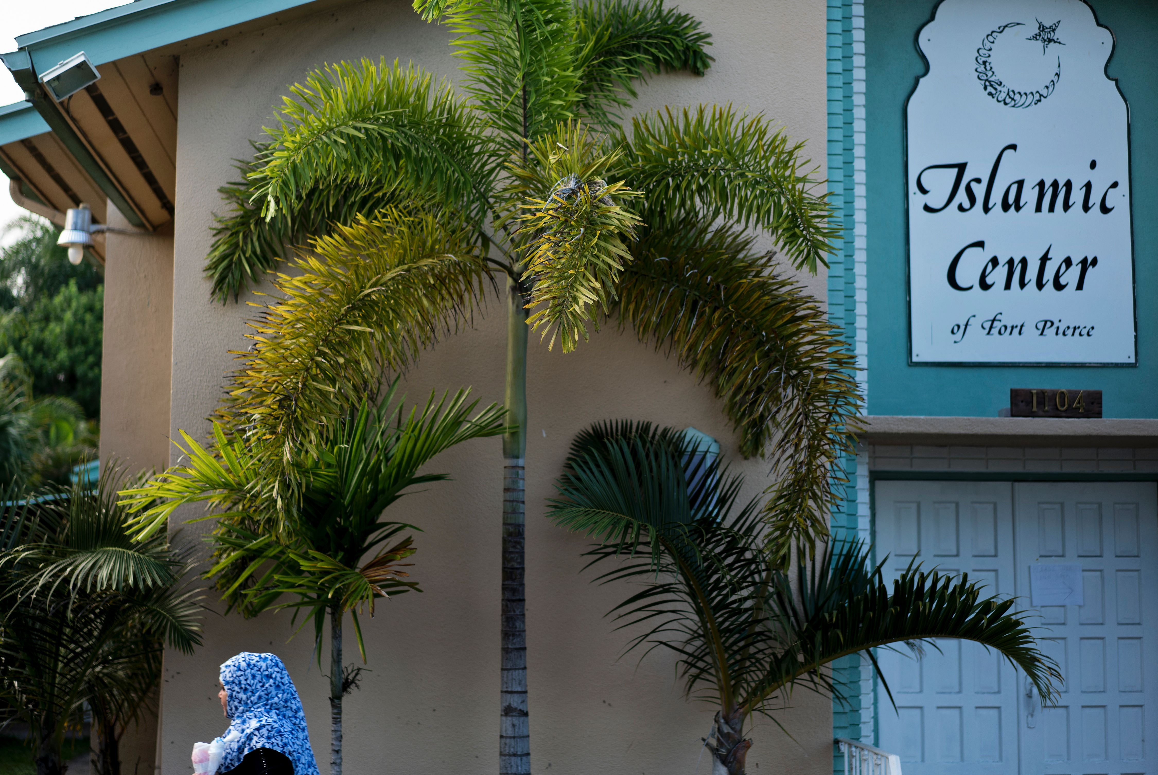 A woman arrives for prayers at the Islamic Center of Fort Pierce where Pulse nightclub shooter Omar Mateen had worshiped on June 14, 2016 in Fort Pierce, Florida.BRENDAN SMIALOWSKI—AFP/Getty Images