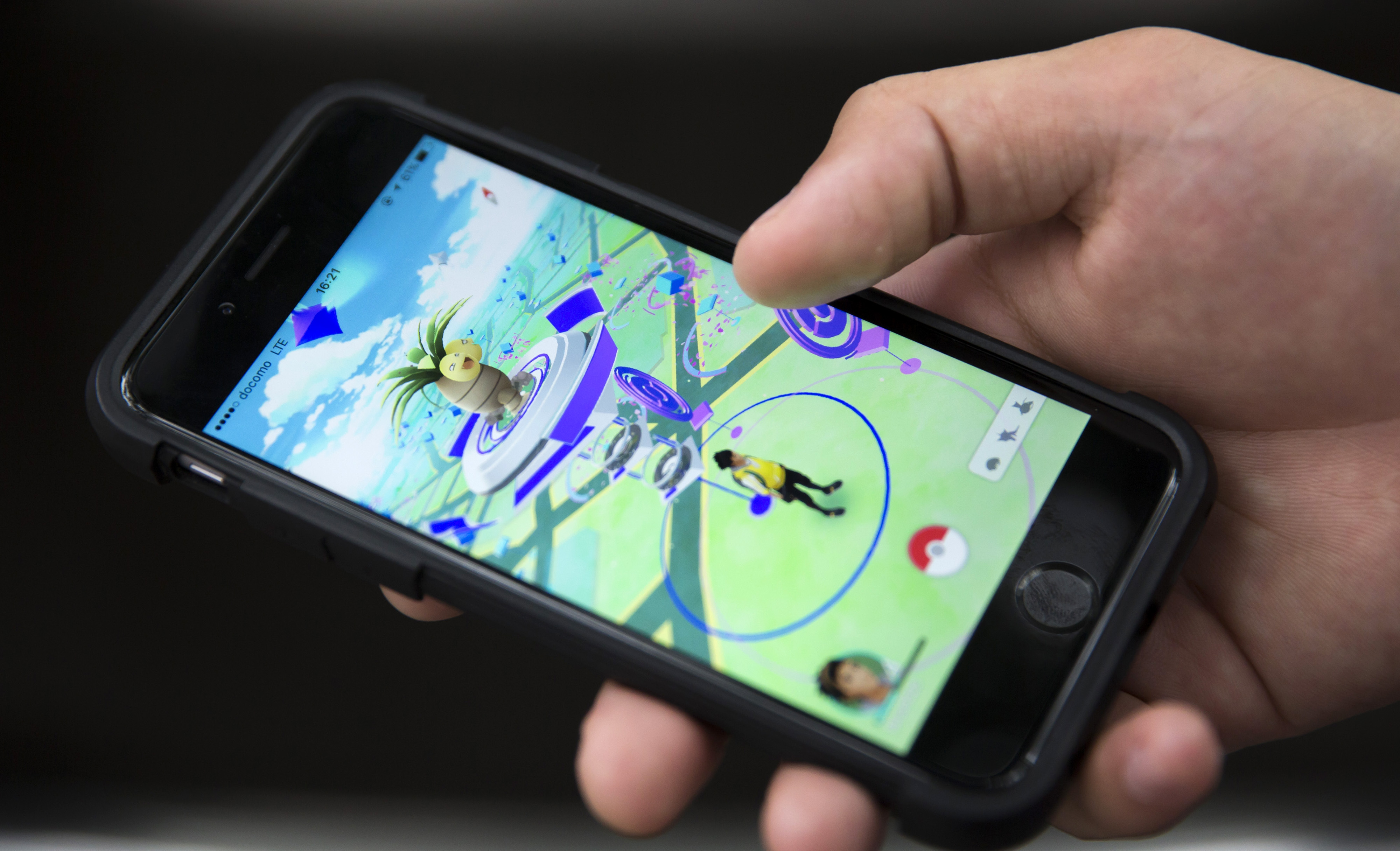 A man plays Pokemon Go game on a smartphone on July 22, 2016 in Tokyo, Japan.