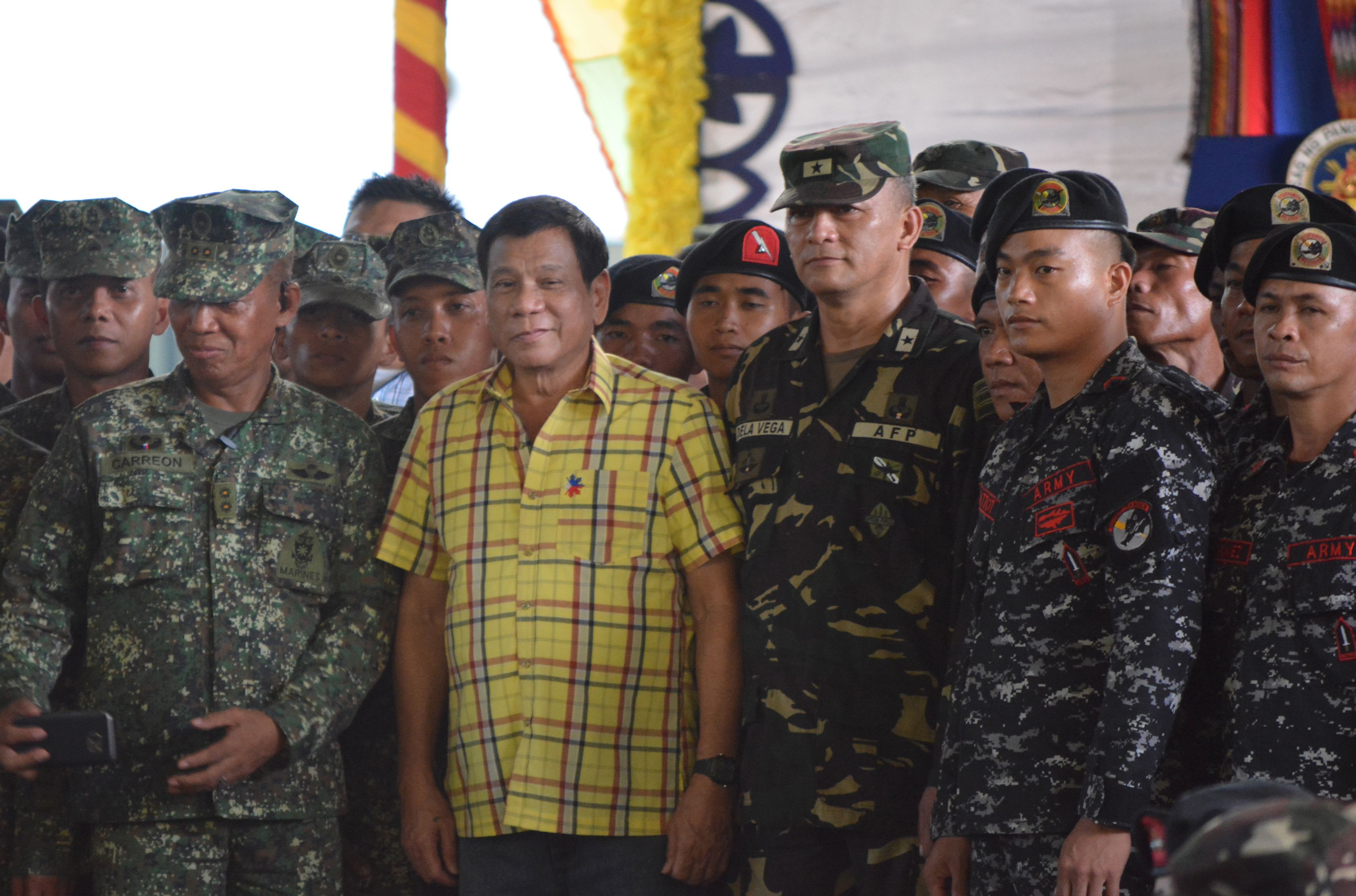 Philippine President Rodrigo Duterte, center left, poses with military personnel during a visit to a military camp in the Philippine town of Jolo, Sulu province, in the southern island of Mindanao, on Aug. 12, 2016