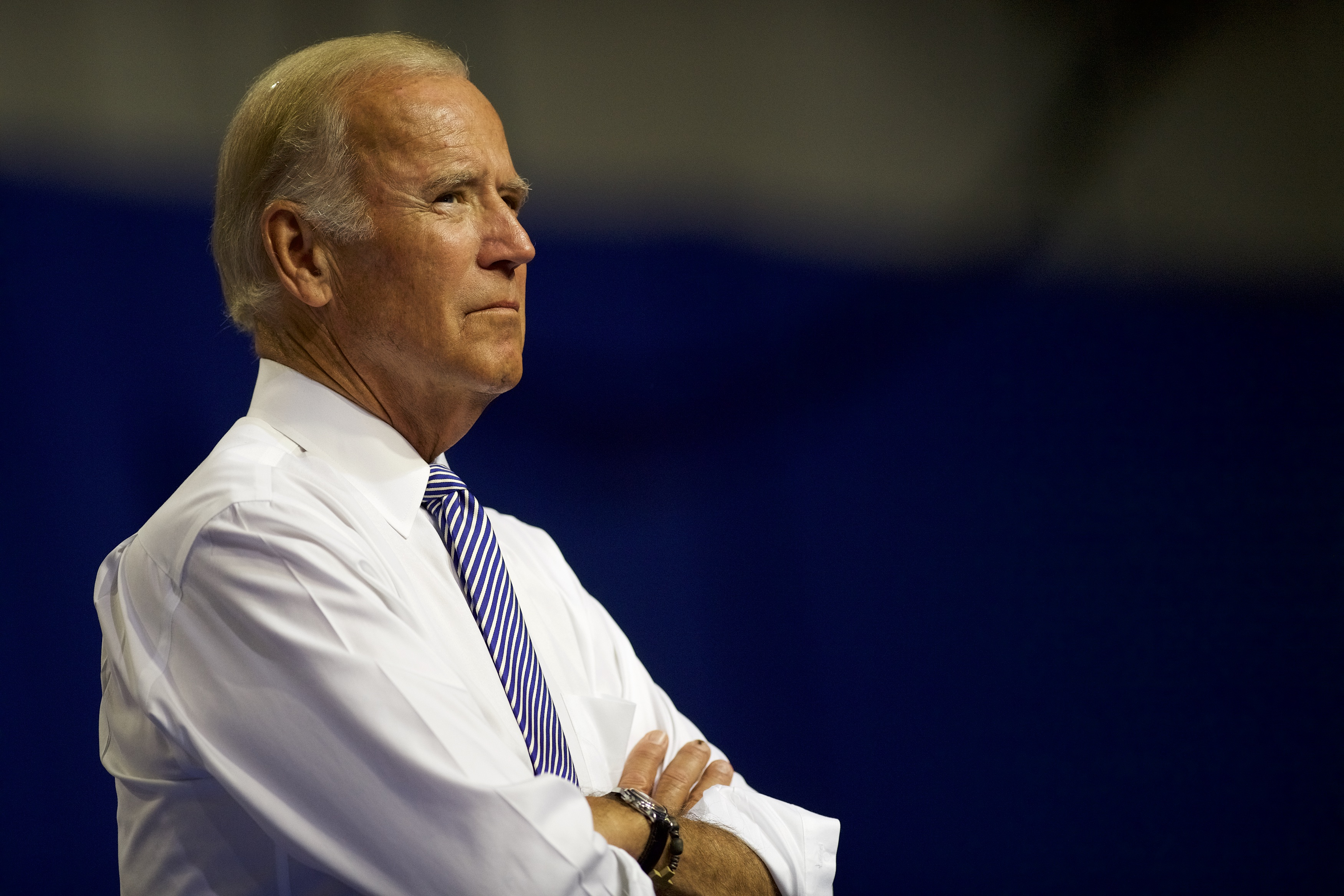 U.S. Vice President Joe Biden listens as Democratic Presidential candidate Hillary Clinton delivers remarks at Riverfront Sports athletic facility on August 15, 2016 in Scranton, Pennsylvania.