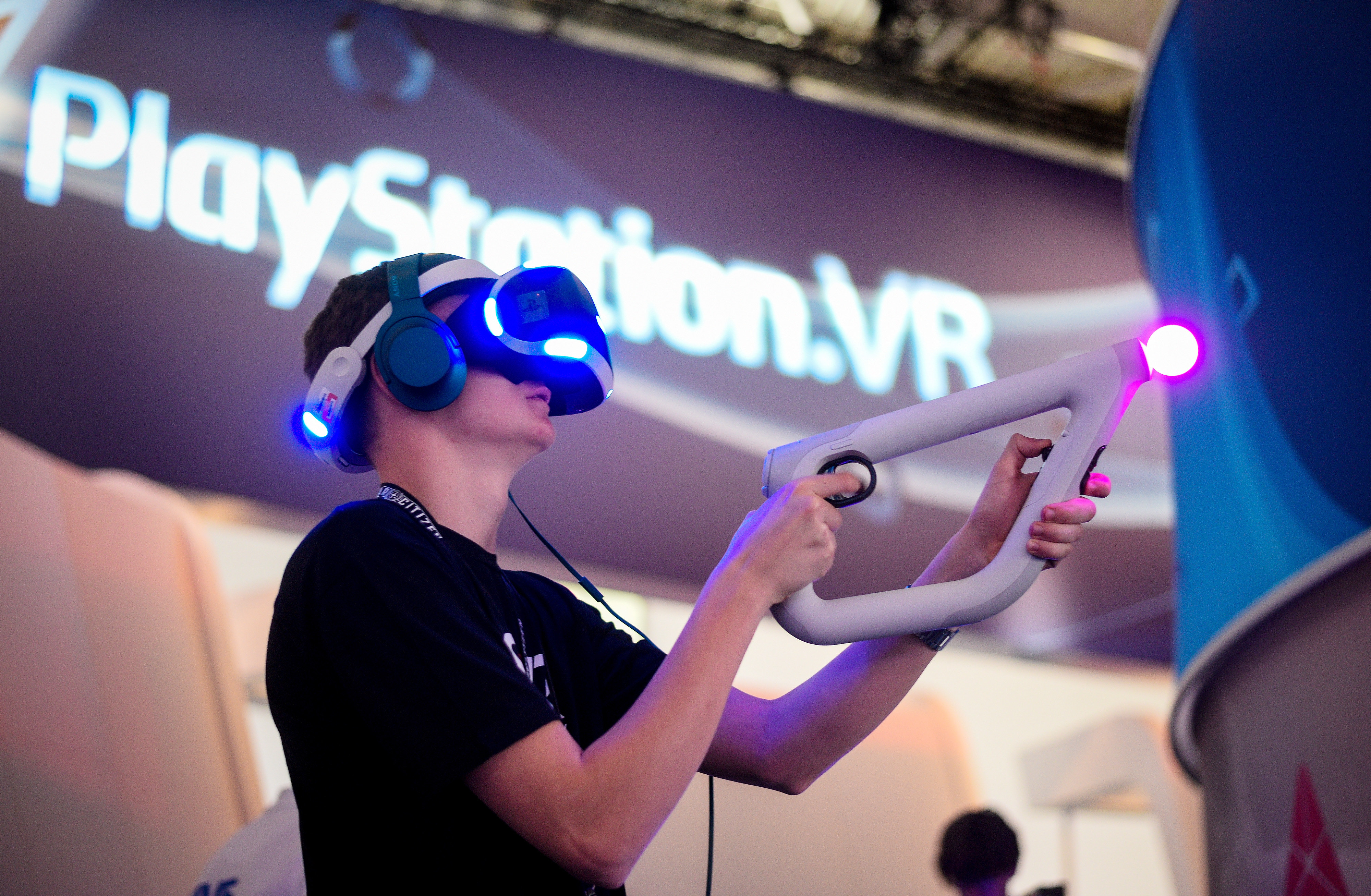 A Visitor try out a VR game at the Sony Play Station stand at the Gamescom 2016 gaming trade fair during the media day on August 17, 2016 in Cologne, Germany.