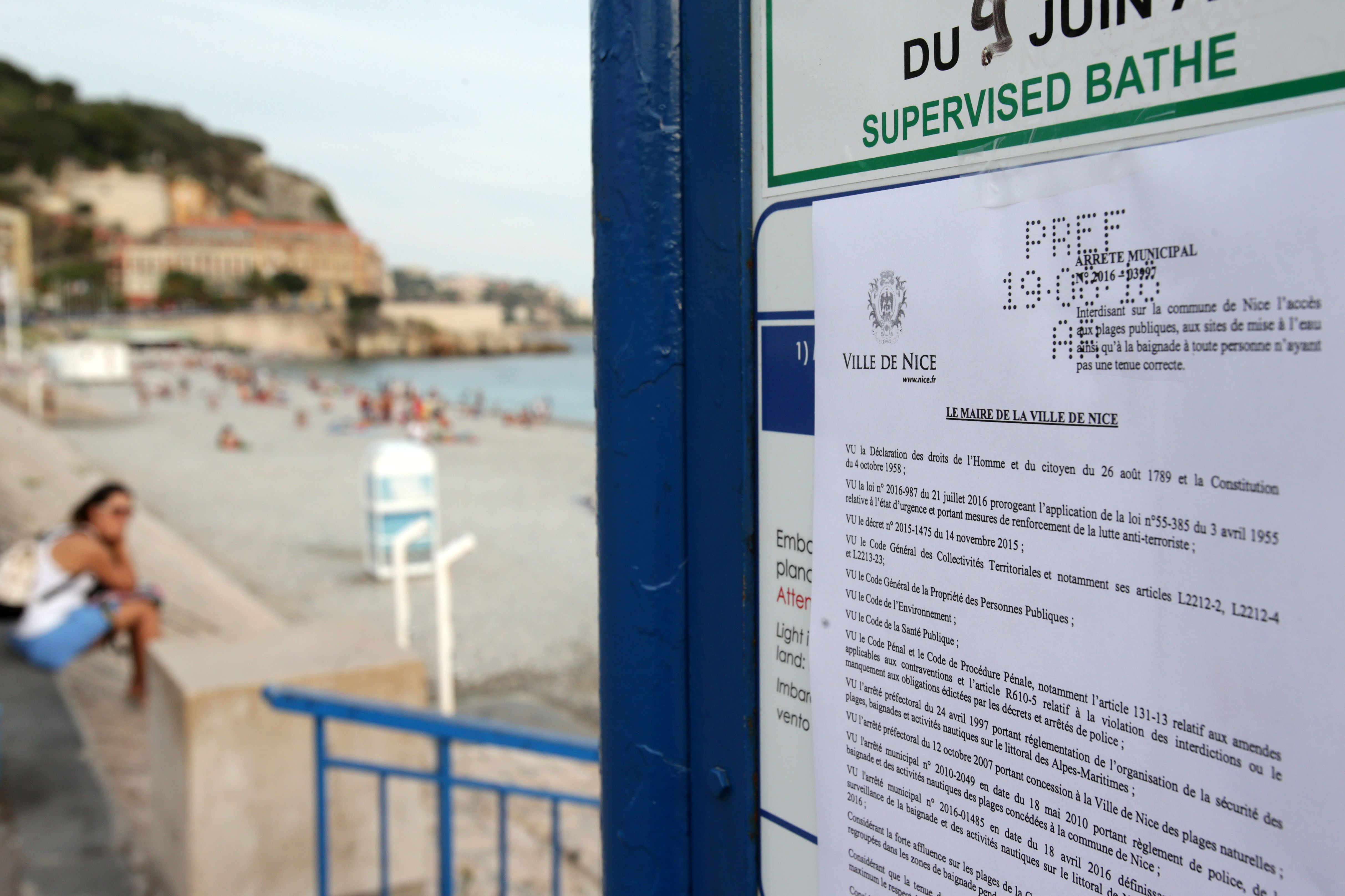 A sign showing the bylaw forbidding women to wear Burkini at the beach in Nice, southeastern France on Aug. 19, 2016.