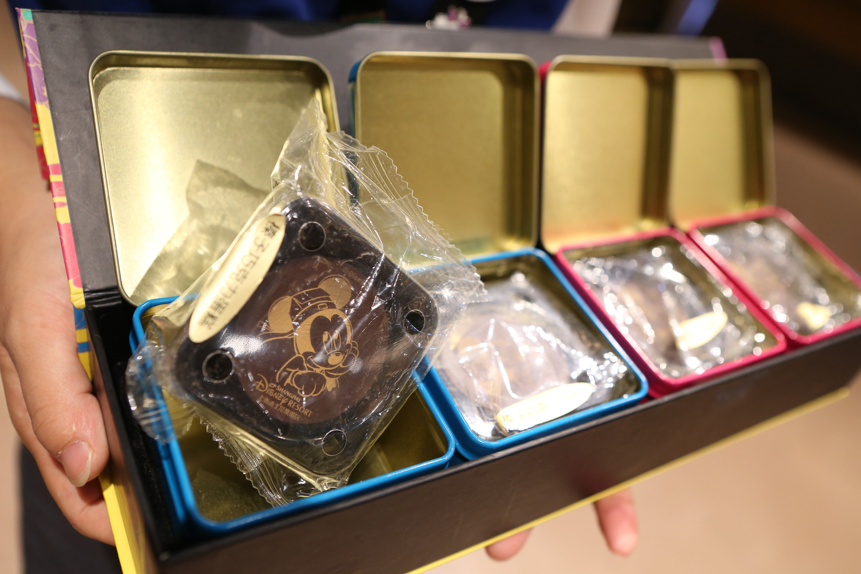 Moon cakes are on display for sale at Disneyland Store in Disneytown on Aug. 27, 2016, in Shanghai