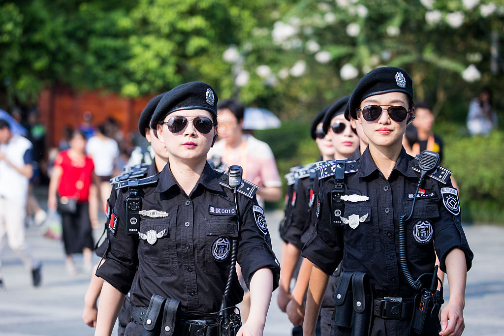 HANGZHOU, CHINA - AUGUST 31: Women police patrol at West Lake resort which will be closed during the G20 Summit on August 31, 2016 in Hangzhou, Zhejiang Province of China. The 2016 Hangzhou G20 Summit will be held in Hangzhou from September 4-5. (Photo by VCG)***_***