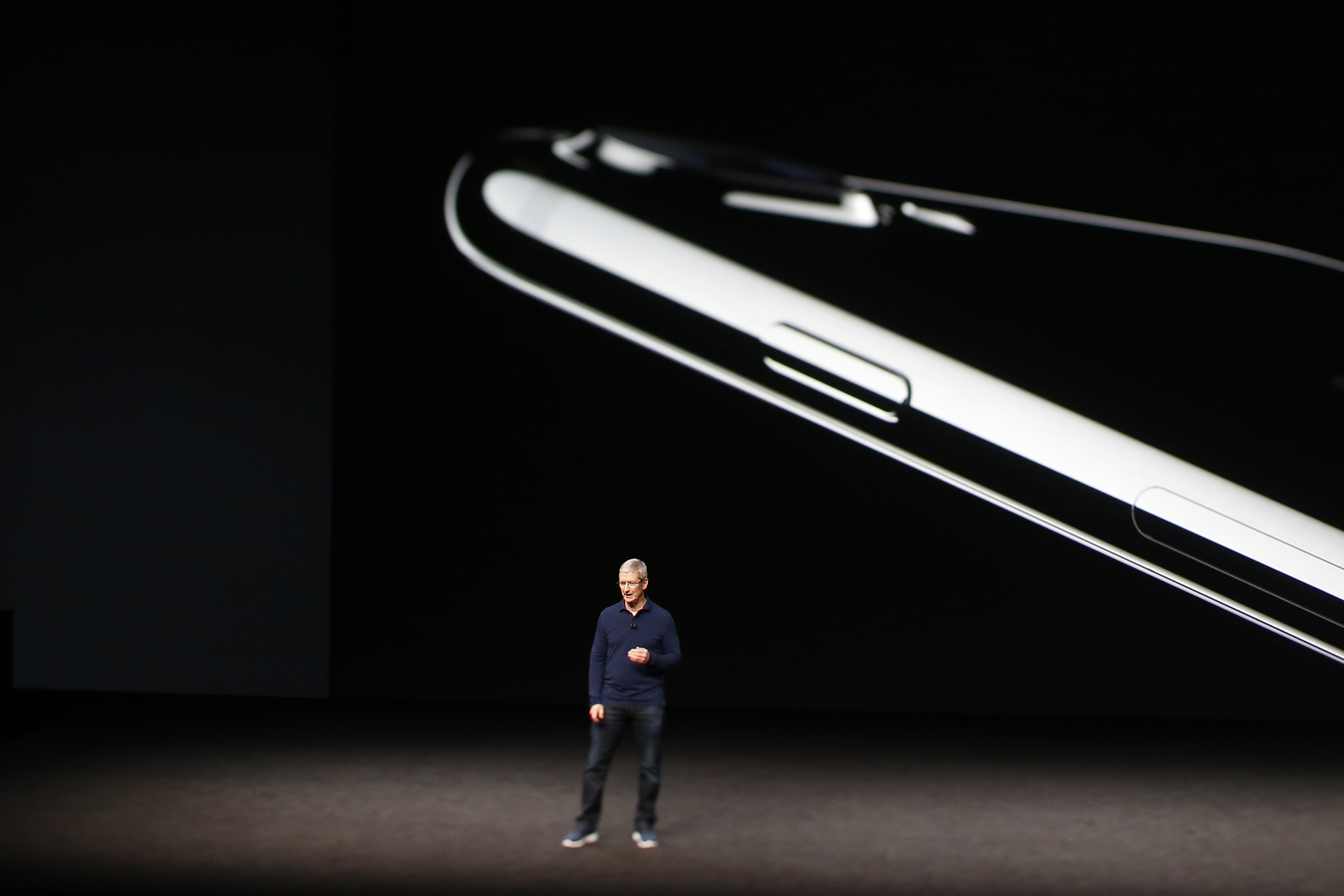 Apple CEO Tim Cook speaks on stage during a launch event on September 7, 2016 in San Francisco, California.