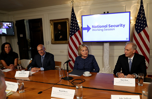 Democratic presidential nominee former Secretary of State Hillary Clinton (C) meets with national security advisors during a National Security Working Session at the New York Historical Society Library on September 9, 2016 in New York City.