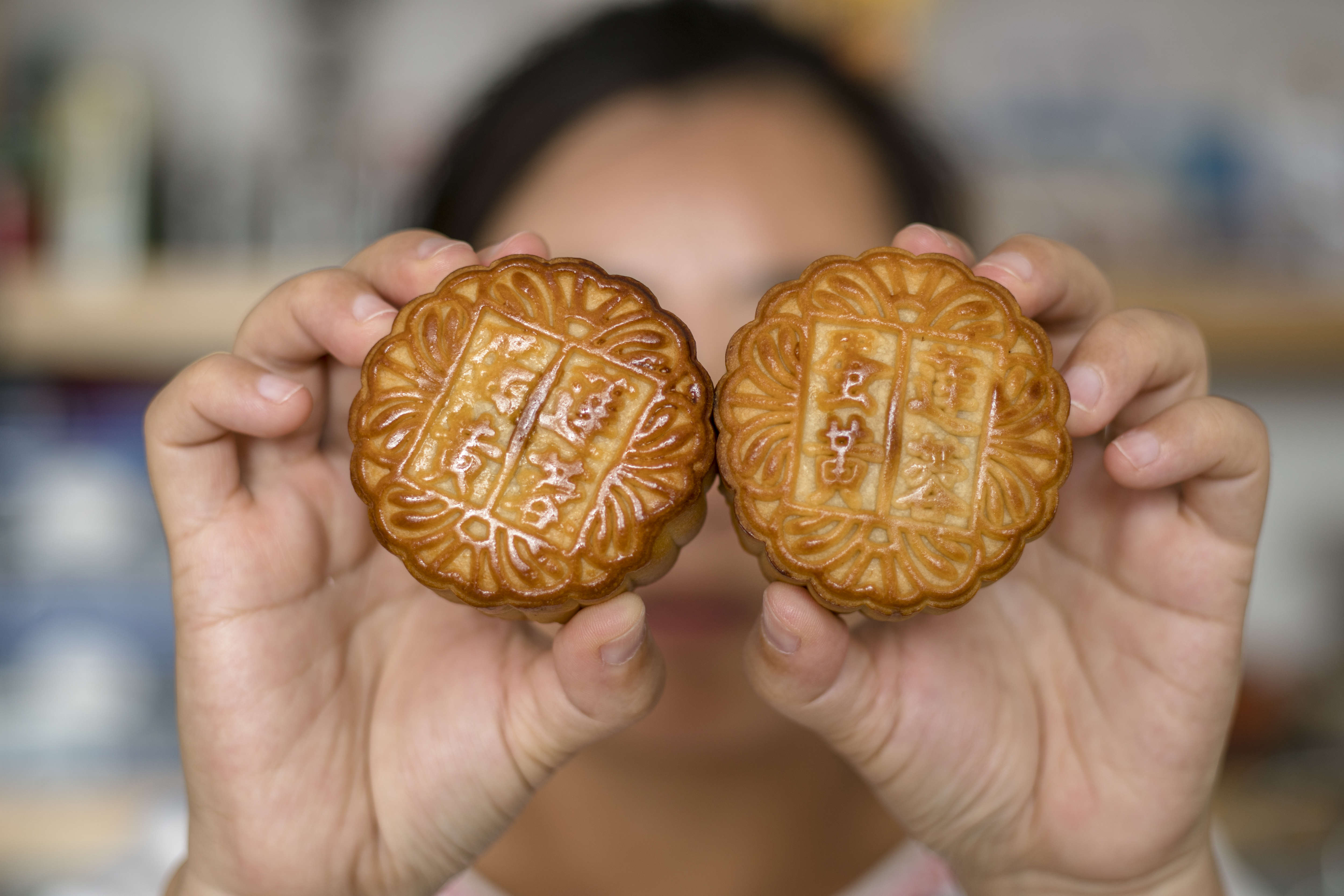A woman in Beijing is holding moon cakes in her hands on Sept. 10, 2016