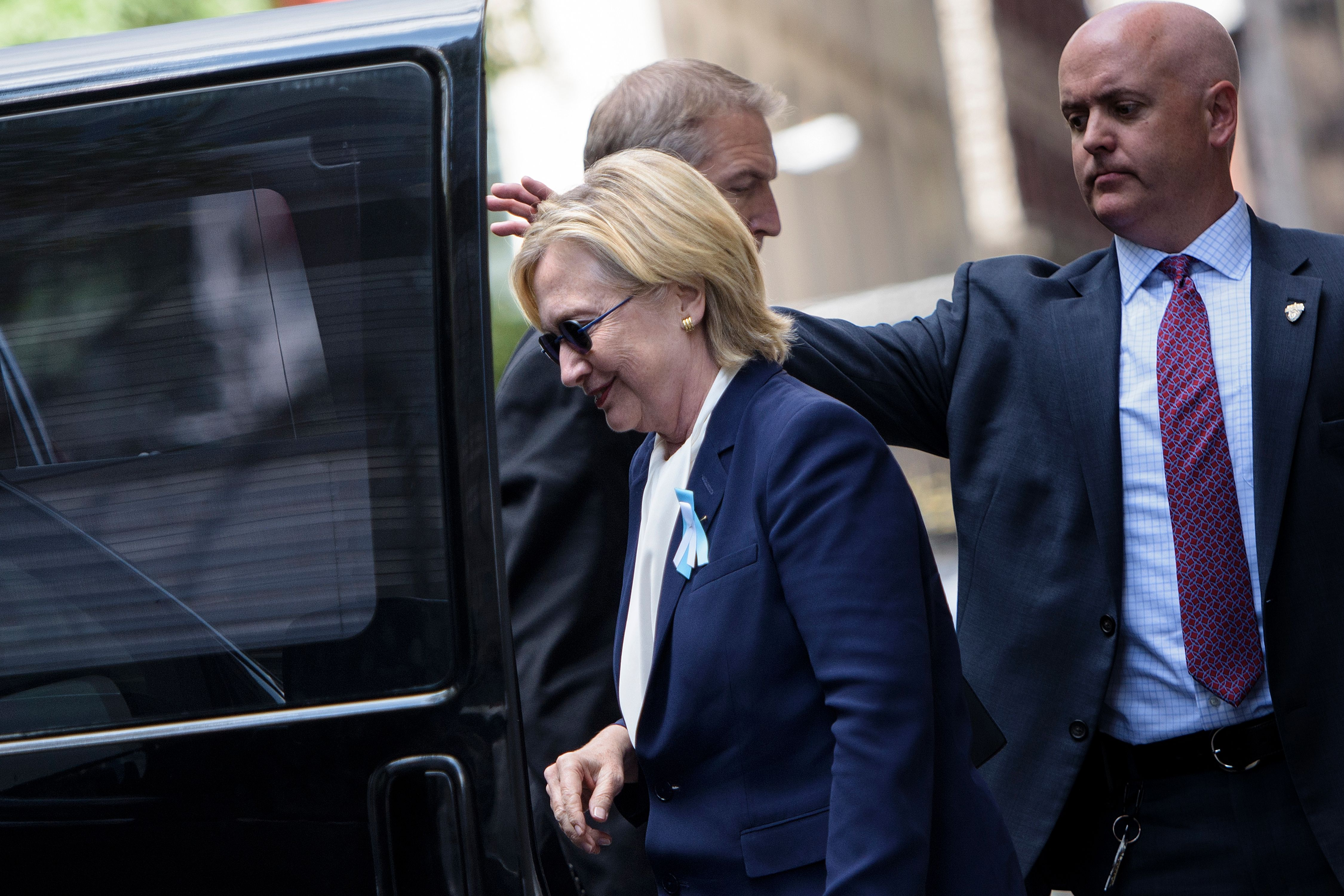 U.S. Democratic presidential nominee Hillary Clinton gets in her car while leaving her daughter's apartment building after resting  on Sept. 11, 2016, in New York.