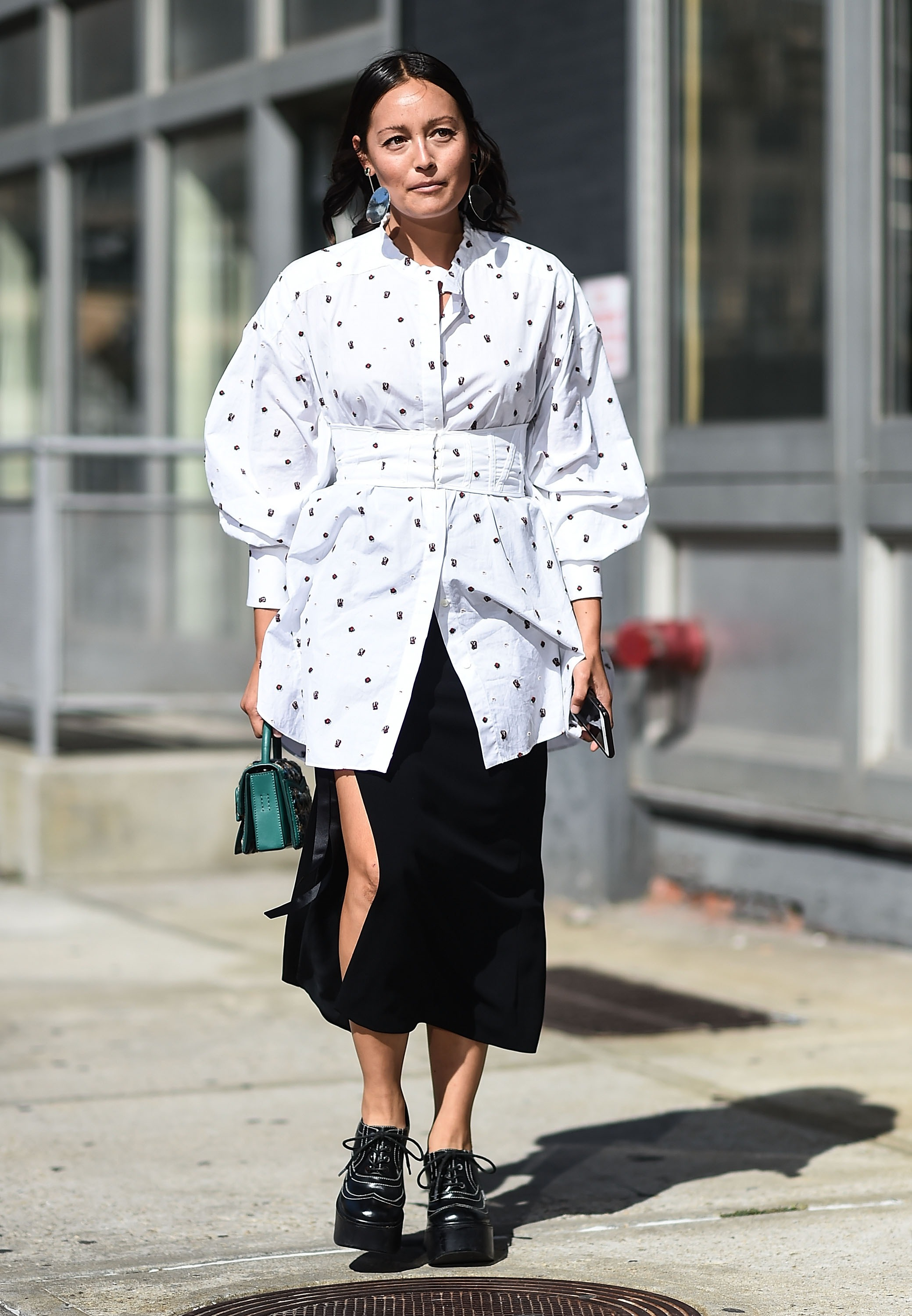 Rachael Wang paired her polka-dotted Ellery blouse with a thigh-revealing black skirt.