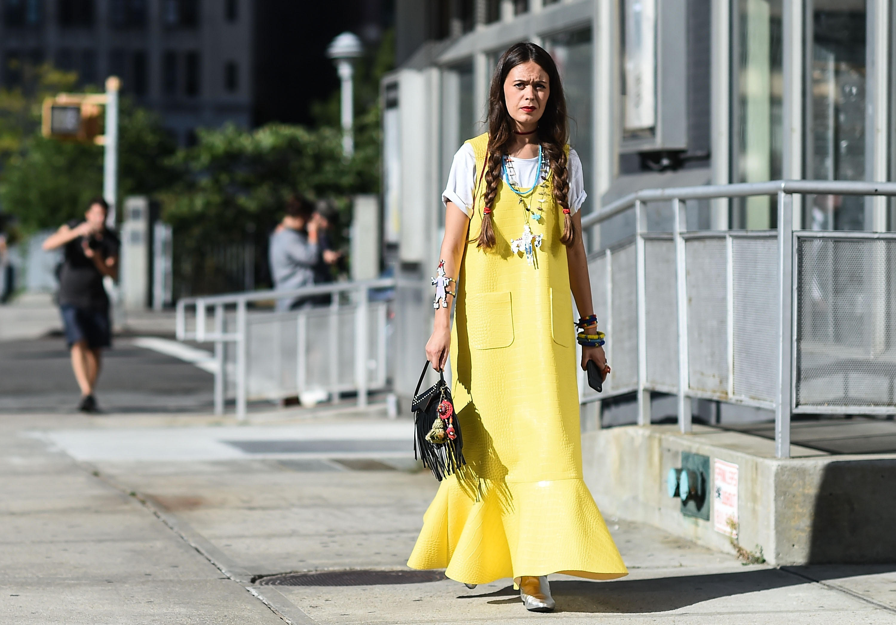 Layering shirts with dresses: This season brought the return of the shirt-dress combo. Give the beloved '90s look an update by pairing a crisp white tee with a dress in this season's whimsical shades and prints.