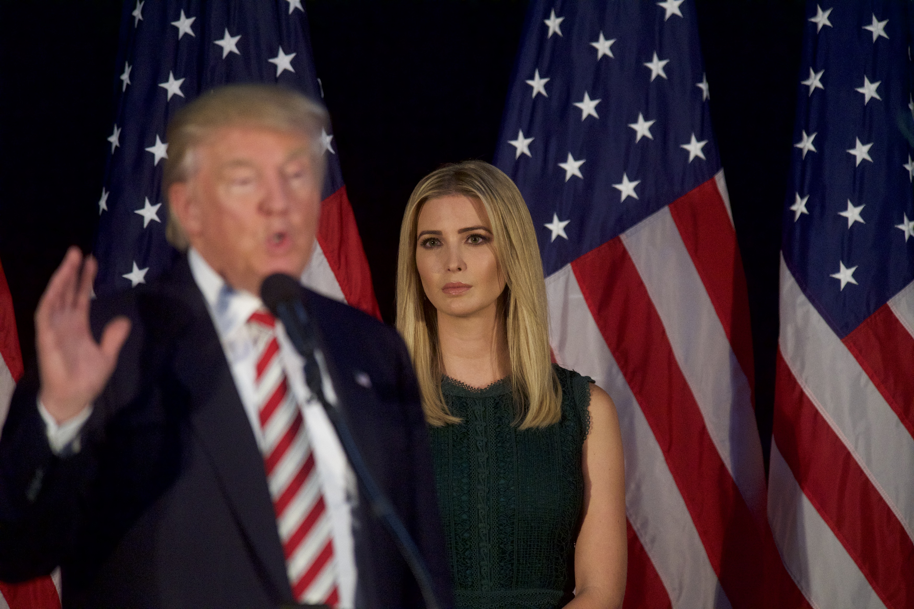 Ivanka Trump looks on as her her father, Republican presidential hopeful Donald J. Trump, speaks during a campaign event at the Aston Township Community Center in Aston, Pa., on Sept.13, 2016.