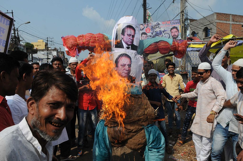BHOPAL, INDIA - SEPTEMBER 23: Muslims burnt the effigy of Pakistan Prime Minister Nawaz Sharif against terrorist attack on army base in Uri, Kashmir, at Qazi Camp area, on September 23, 2016 in Bhopal, India. The attack led to the death of 17 Soldiers and 4 Terrorists. Indian Army initial reports indicate that Jaish-e-Mohammad terrorists could be behind the attack.   (Photo by Praveen Bajpai/Hindustan Times via Getty Images)