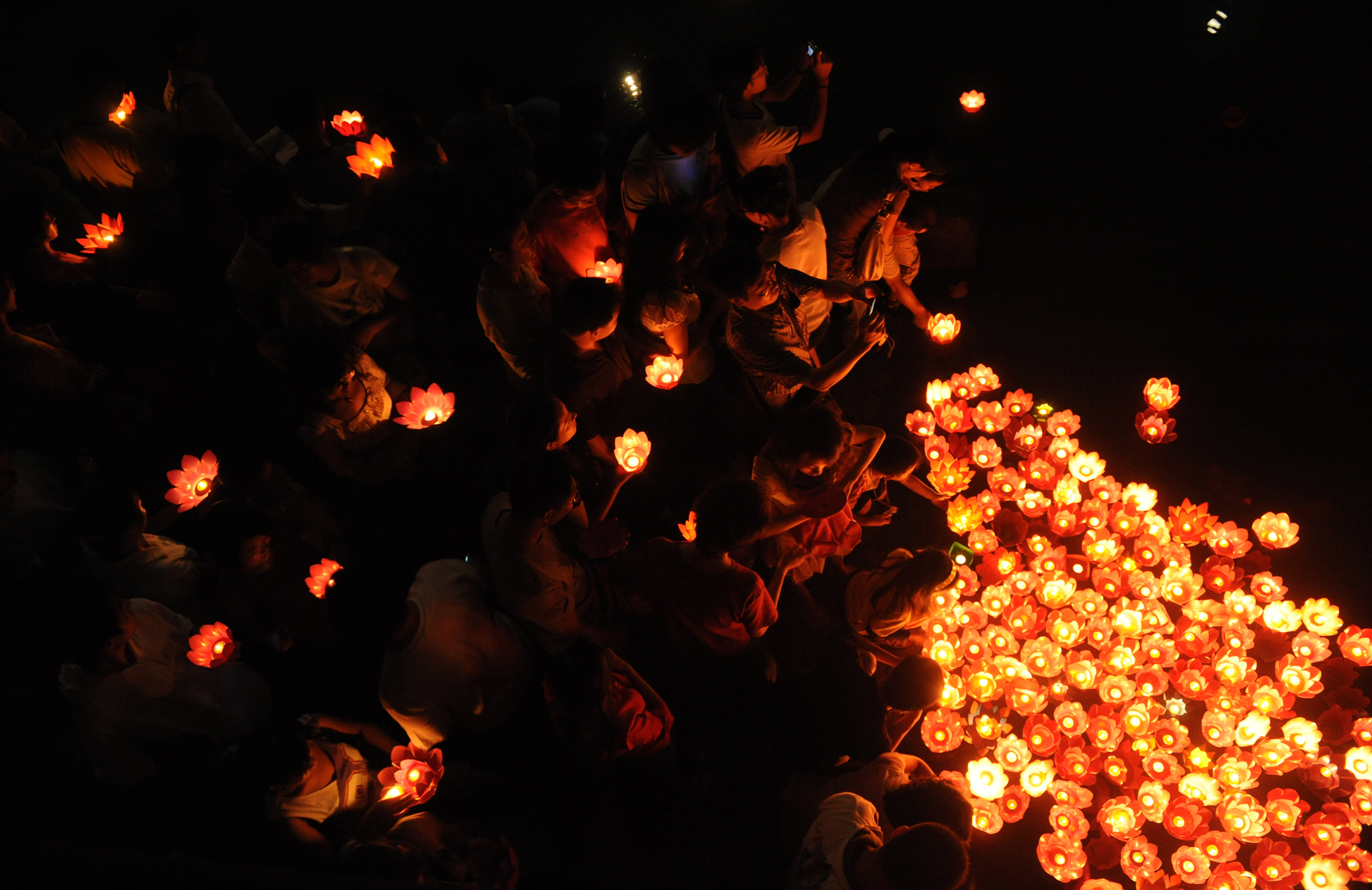 Residents lay candles on a river to mark the Mid-Autumn Festival on Sept. 14, 2008, in Chengdu, Sichuan province, China.
