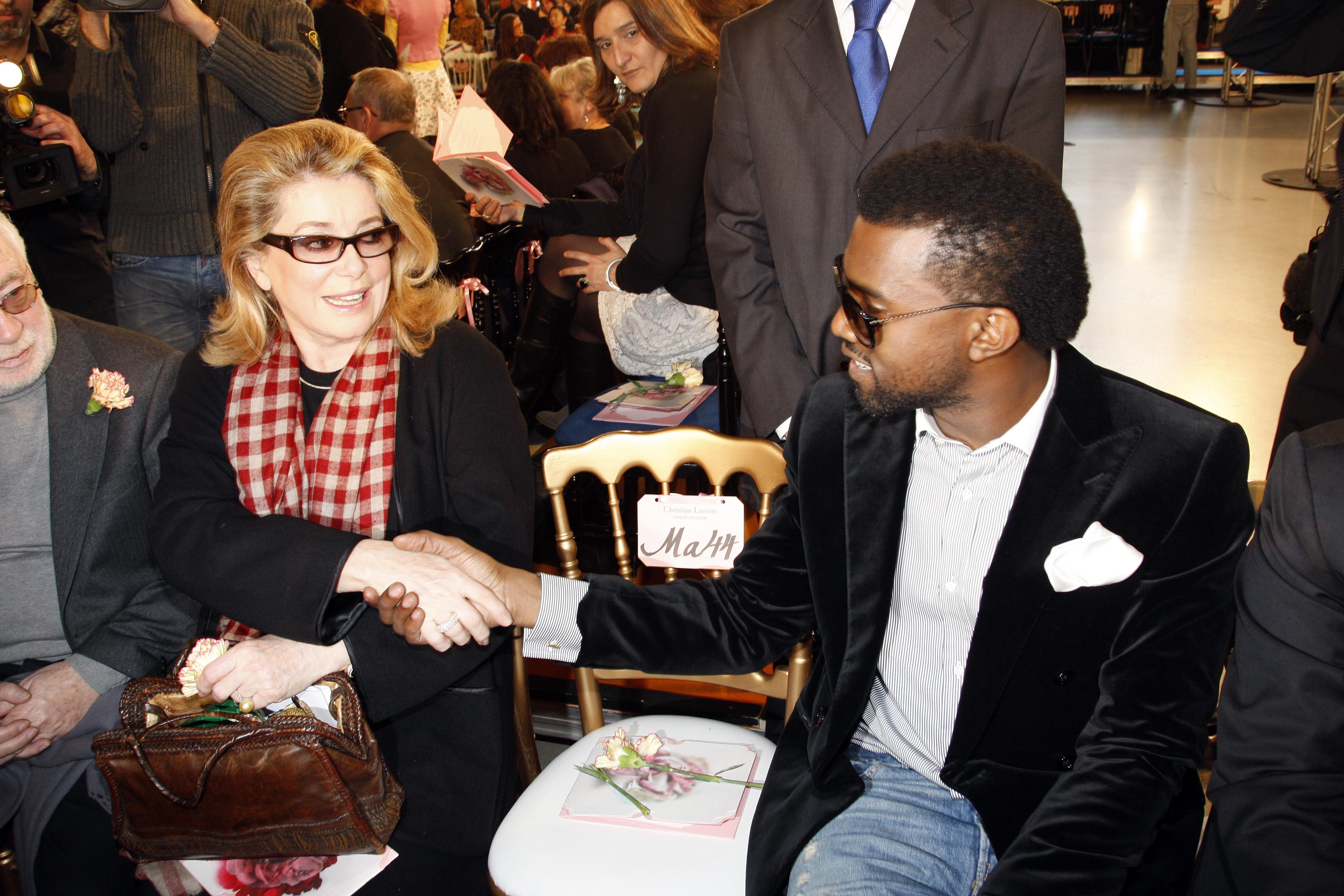 Catherine Deneuve and Kanye West at the Christian Lacroix Spring 2009 couture show.