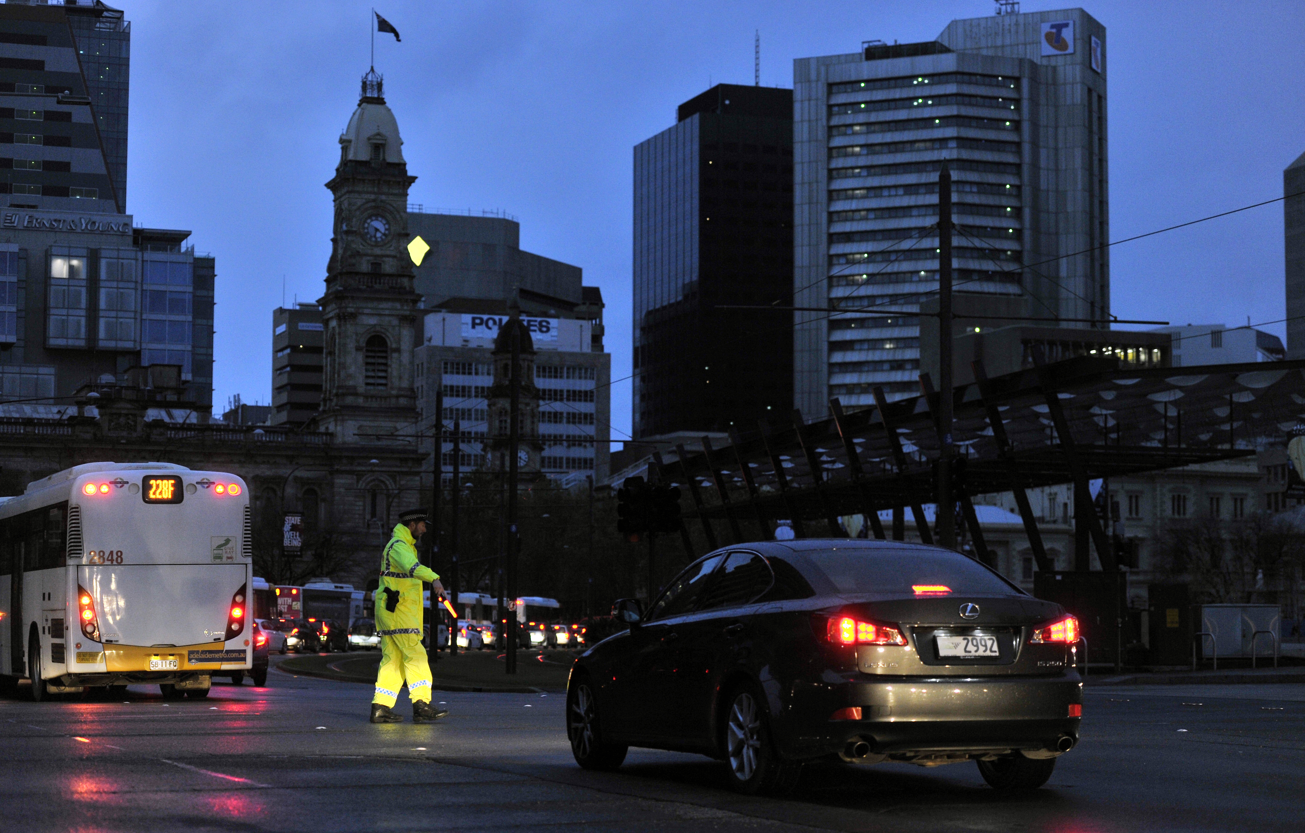 Police direct traffic in Adelaide on Sept. 28, 2016, after the power network stopped working, creating a broad blackout in South Australia