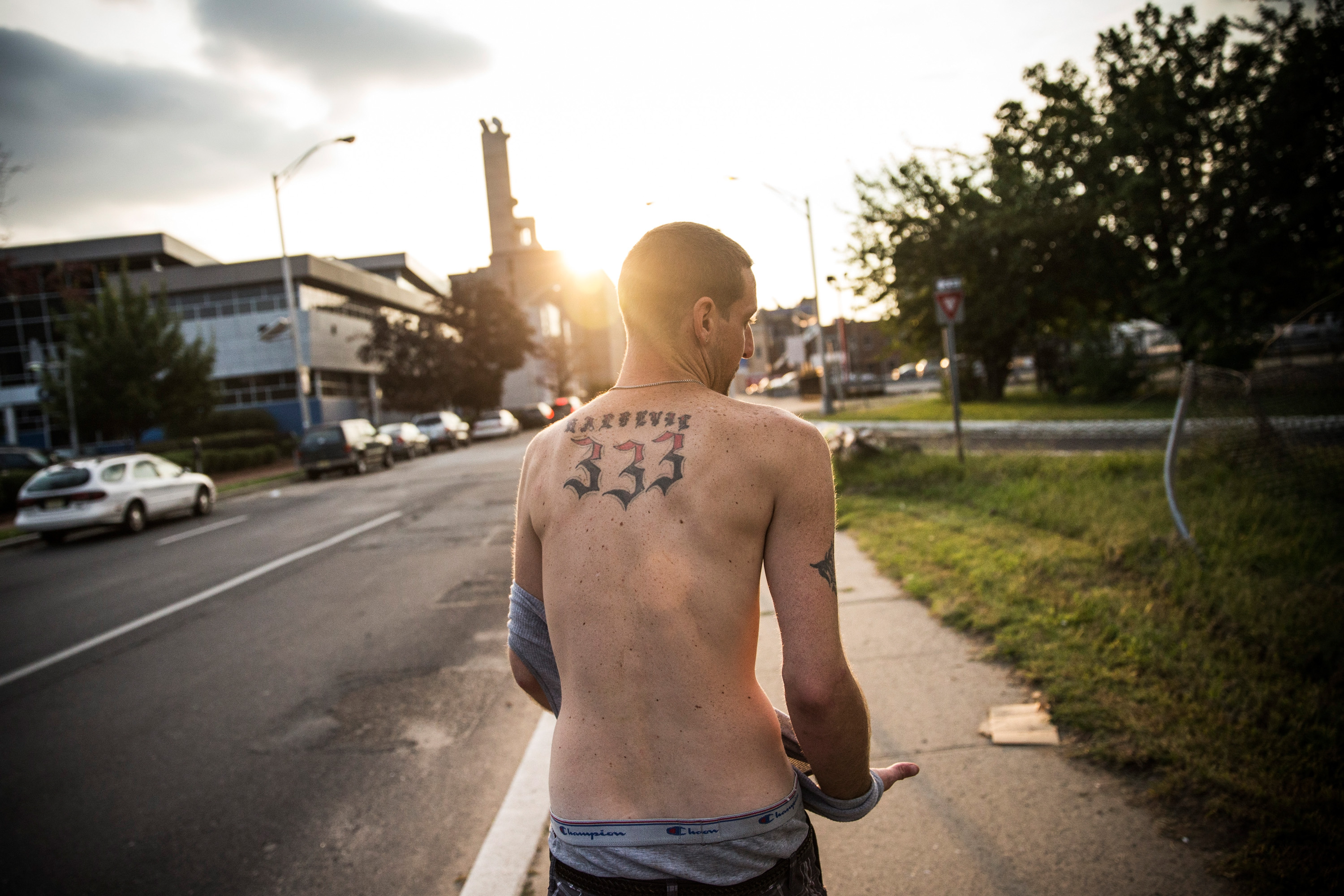Reggy Colby, age 30 and a recovering heroin addict, walks down the street, on Aug. 21, 2013 in Camden, NJ.