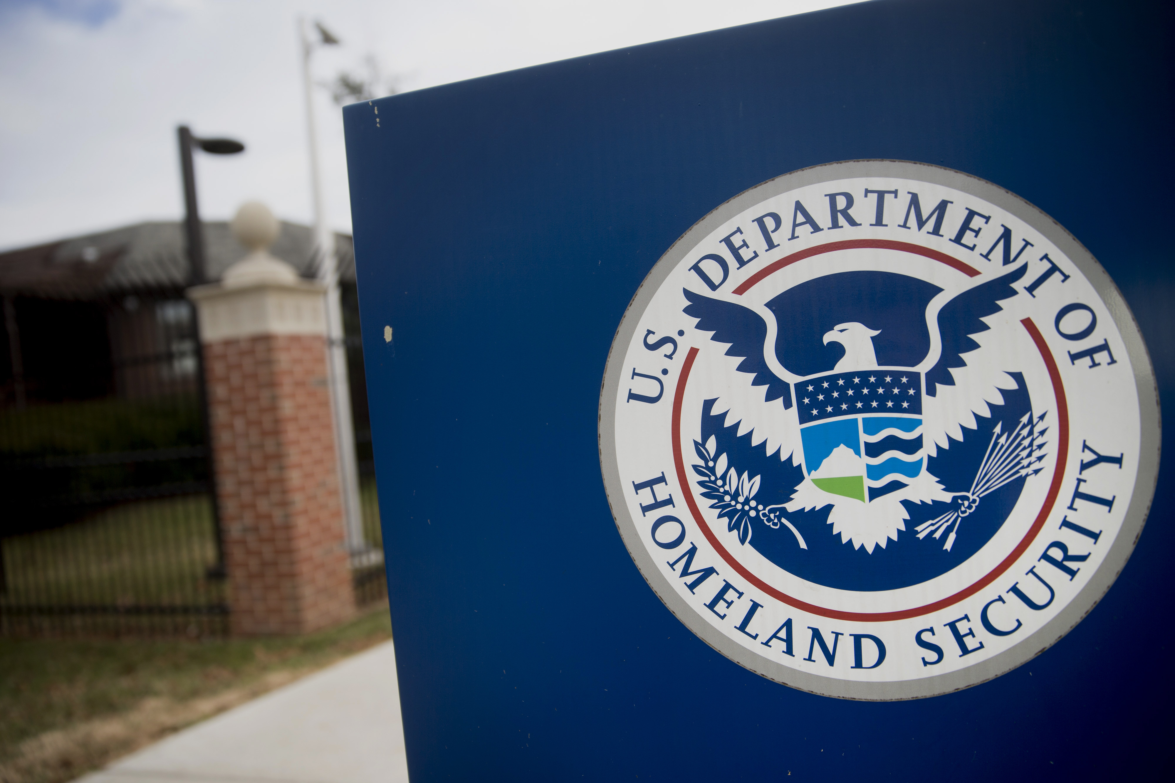 The U.S. Department of Homeland Security (DHS) seal stands at the agency's headquarters in Washington, D.C., U.S., on Thursday, Dec. 11, 2014. The U.S. House is set to pass a $1.1 trillion spending bill that includes a banking provision opposed by many Democrats as a giveaway to large institutions. Current funding for the government ends today, and the measure would finance most of the government through September 2015. The DHS, responsible for immigration policy, would be financed only through Feb. 27. Photographer: Andrew Harrer/Bloomberg via Getty Images