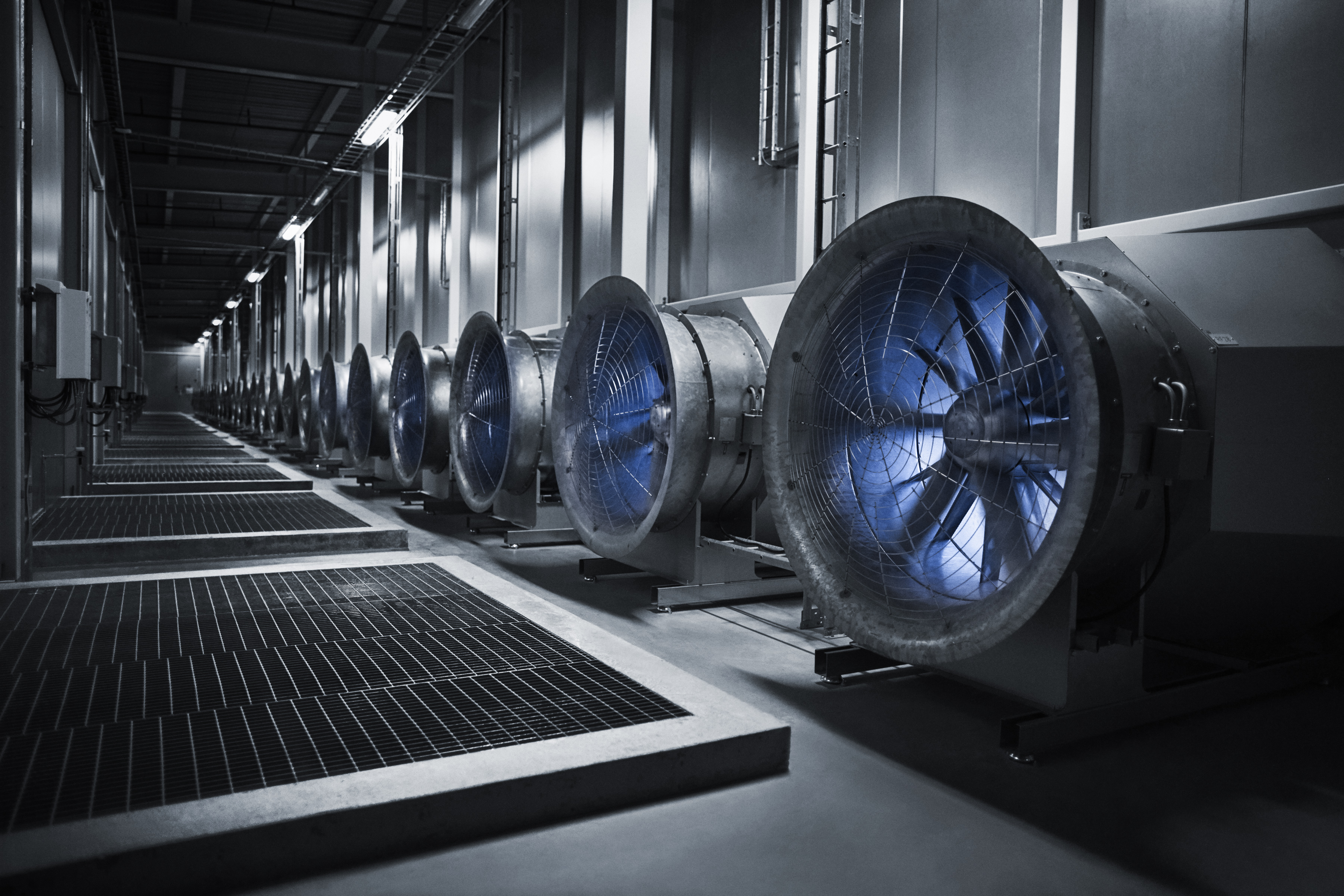 These fans draw in air from the outside to cool the servers down. Conversely, when temperatures drop during the winter, heat from the servers warm the building.