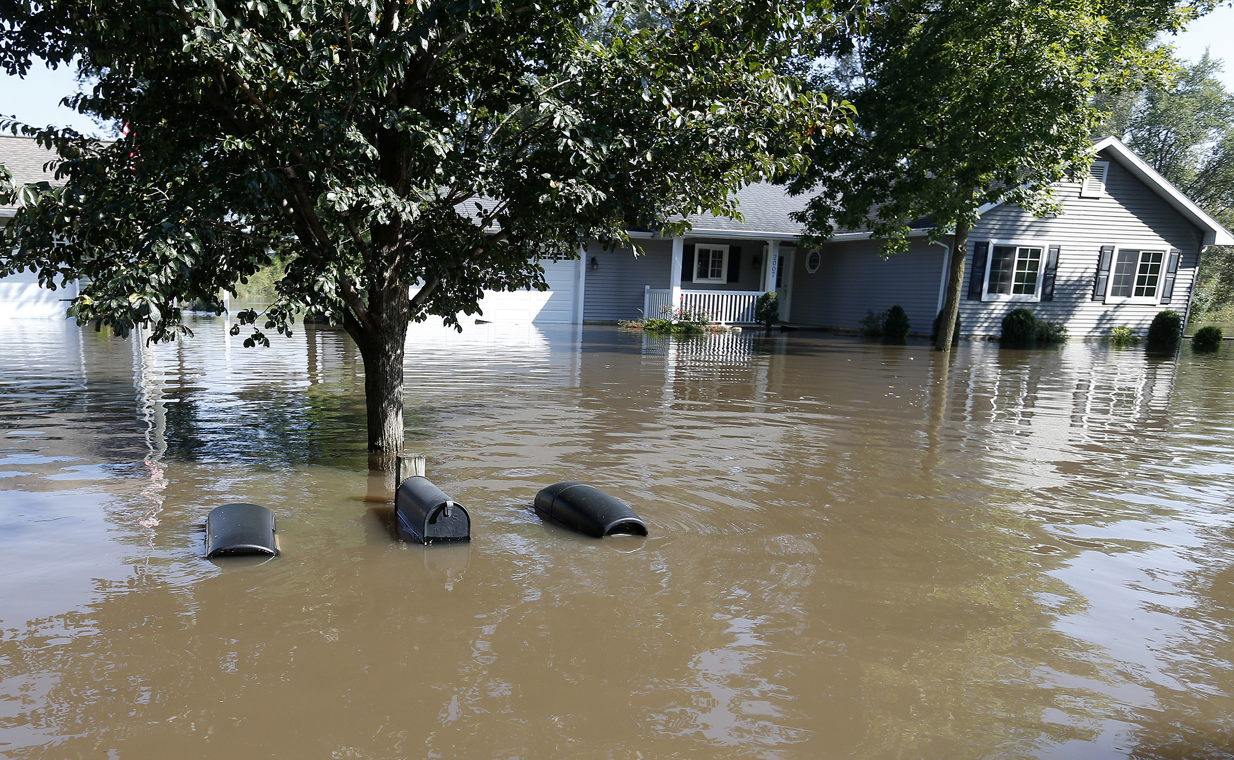 The tops of mailboxes barely break the surface of floodwaters from the Cedar River in the North Cedar neighborhood of Cedar Falls, Iowa, Sept. 24, 2016.