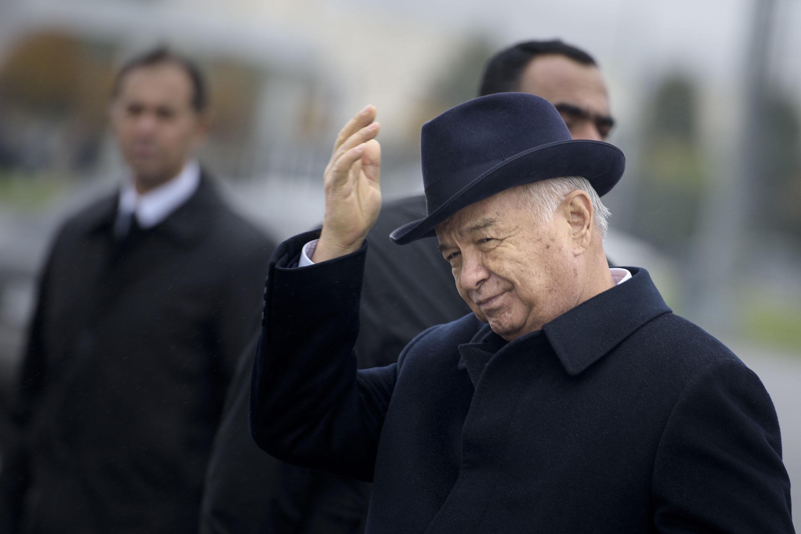 Uzbek President Islam Karimov gestures after greeting US Secretary of State John Kerry at Samarkand Airport on Nov. 1, 2015.