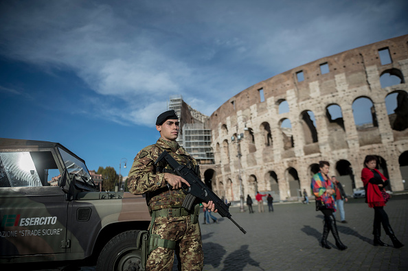 Italian soldiers patrol in front of the Colosseum, on Nov. 24, 2015 in Rome. The security have been tightened after deadly attacks in Paris on November 13.
