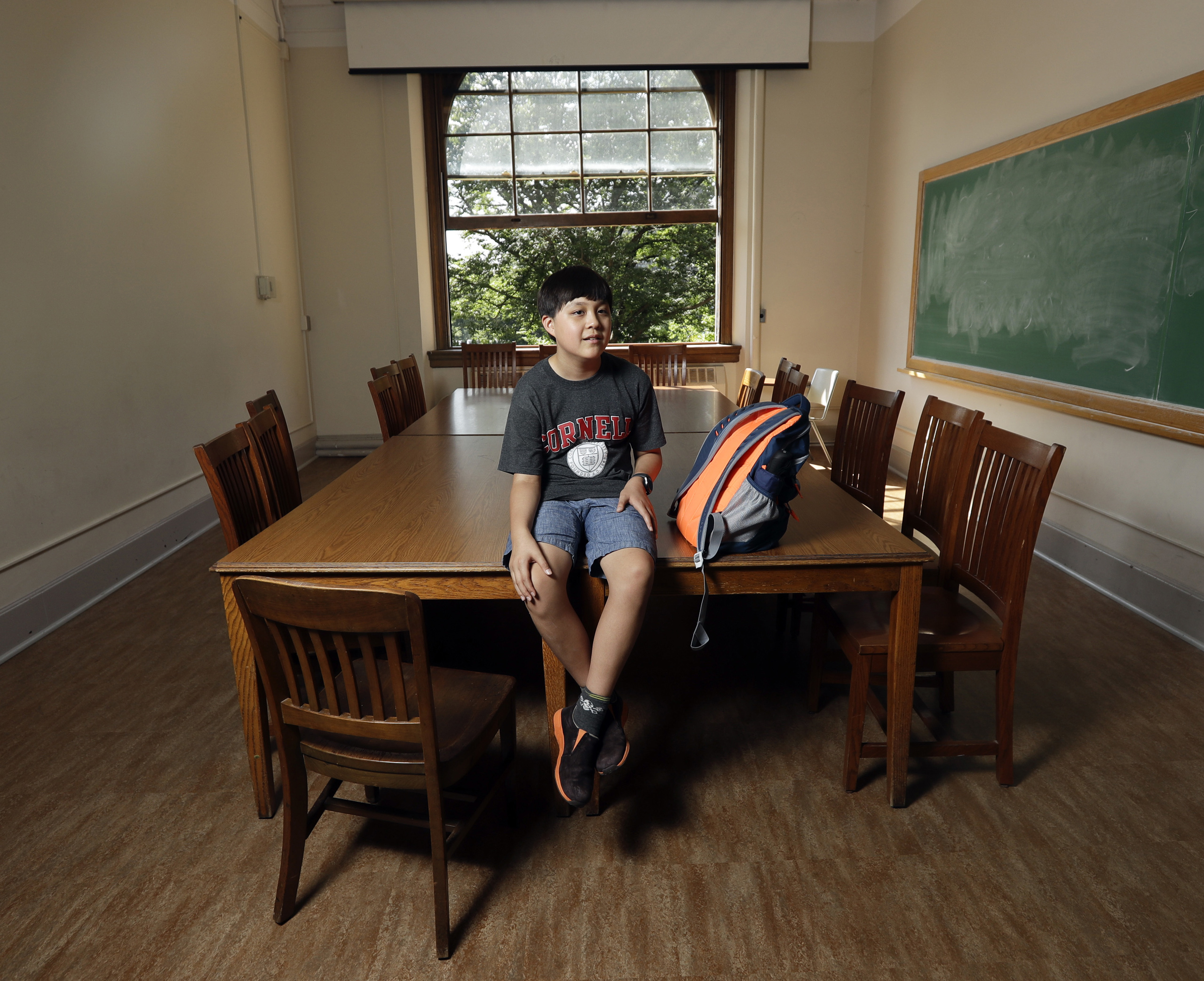 Jeremy Shuler, 12, a freshman at Cornell University, poses on campus in Ithaca, N.Y. He's the youngest student on record to attend the Ivy League school on Aug. 26, 2016.