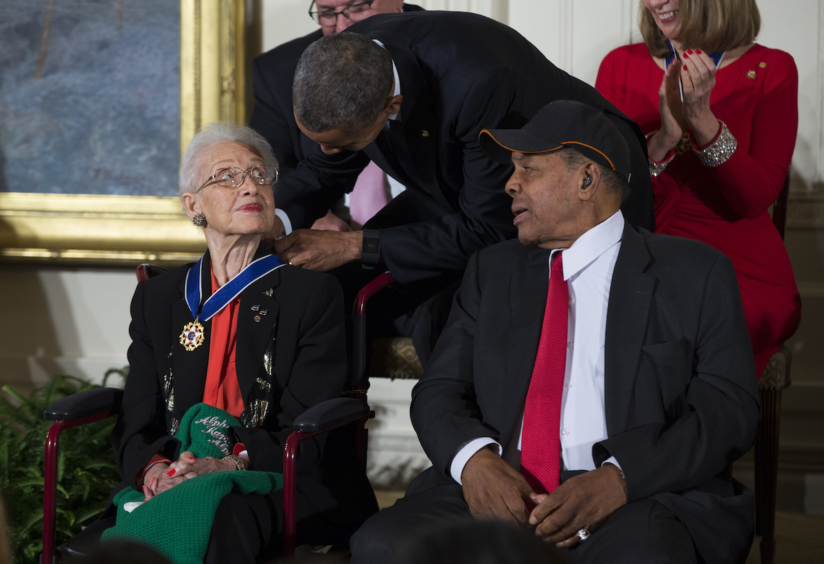 Willie Mays, right, watches as President Barack Obama presents the Presidential Medal of Freedom to NASA mathematician Katherine Johnson during a ceremony in the East Room of the White House, on Nov. 24, 2015, in Washington.