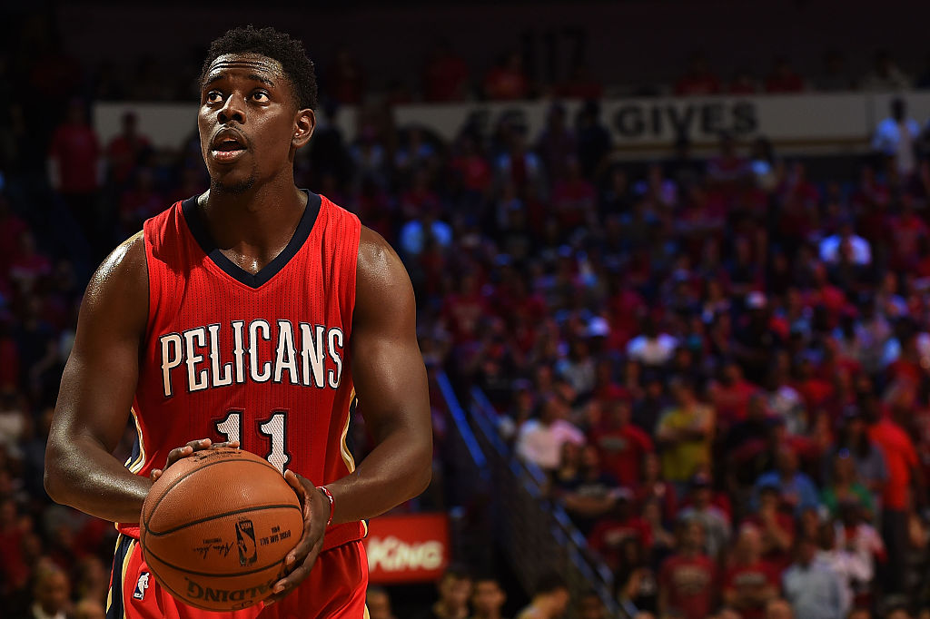 Jrue Holiday of the New Orleans Pelicans shoots a free throw during a game against the San Antonio Spurs at the Smoothie King Center on April 15, 2015 in New Orleans, Louisiana.