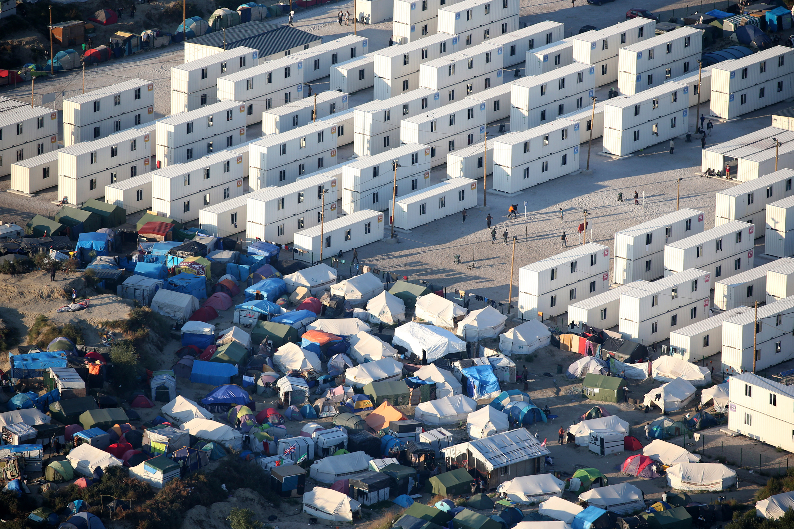 An aerial view shows makeshift shelters, tents and containers where migrants live in what is known as the  Jungle , a sprawling camp in Calais, France, on Sept. 7, 2016.