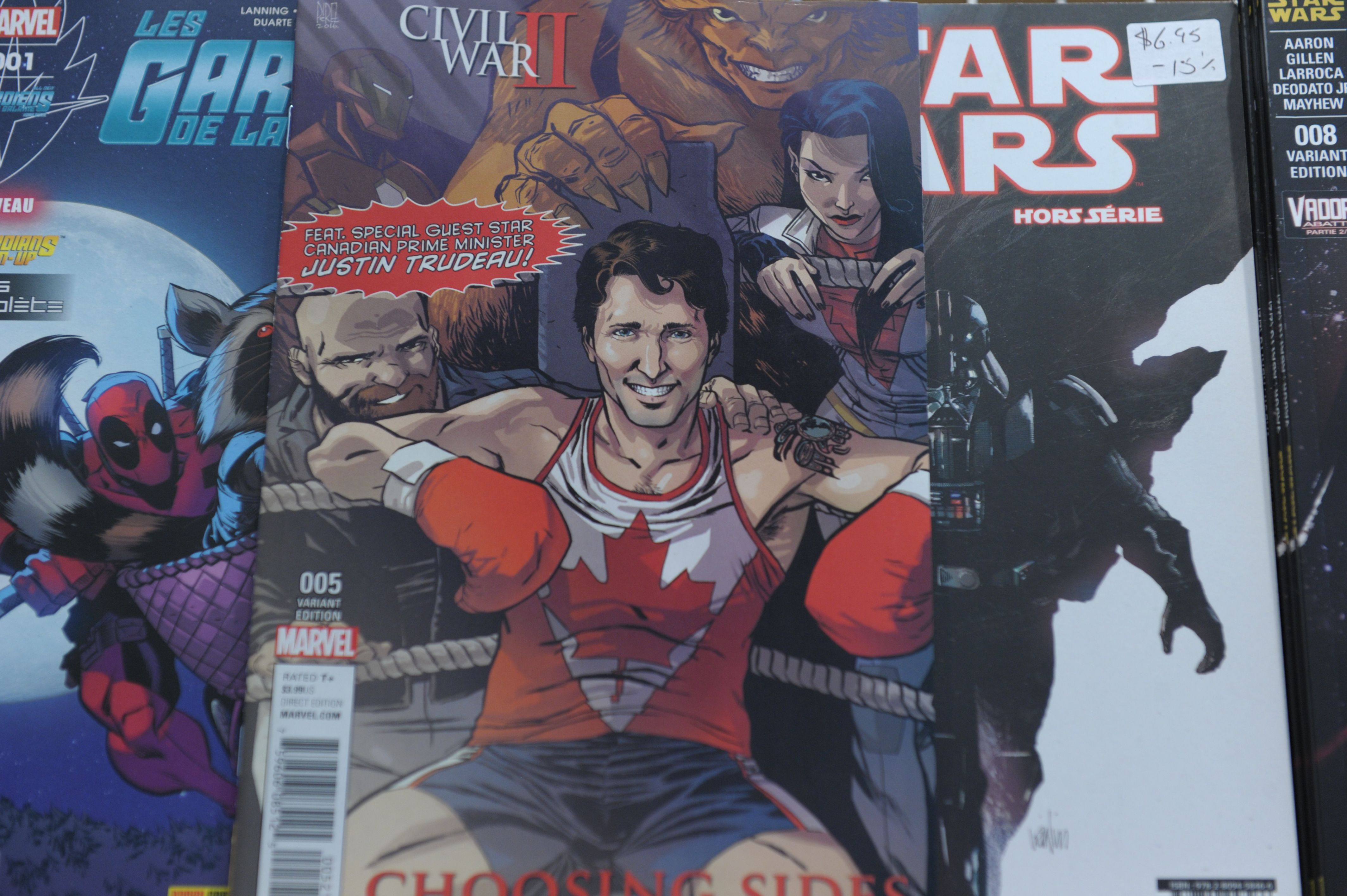The cover of US publisher Marvel's comic book, featuring Canadian Prime Minister Justin Trudeau as a super hero in front of a newstand in Montreal, Canada on Aug. 31, 2016.                                           Canadian Prime Minister Justin Trudeau takes the role of a superhero in a comic book by US publisher Marvel released on newsstands August 31 in Canada. Trudeau appears smiling in a corner of a boxing ring on the cover of the comic book, a limited edition in English of the series  Civil War II: Choosing Sides  wearing a maple leaf shirt.  / AFP / Marc BRAIBANT / TO GO WITH AFP STORY BY MARC BRAIBANT        (Photo credit should read MARC BRAIBANT/AFP/Getty Images)