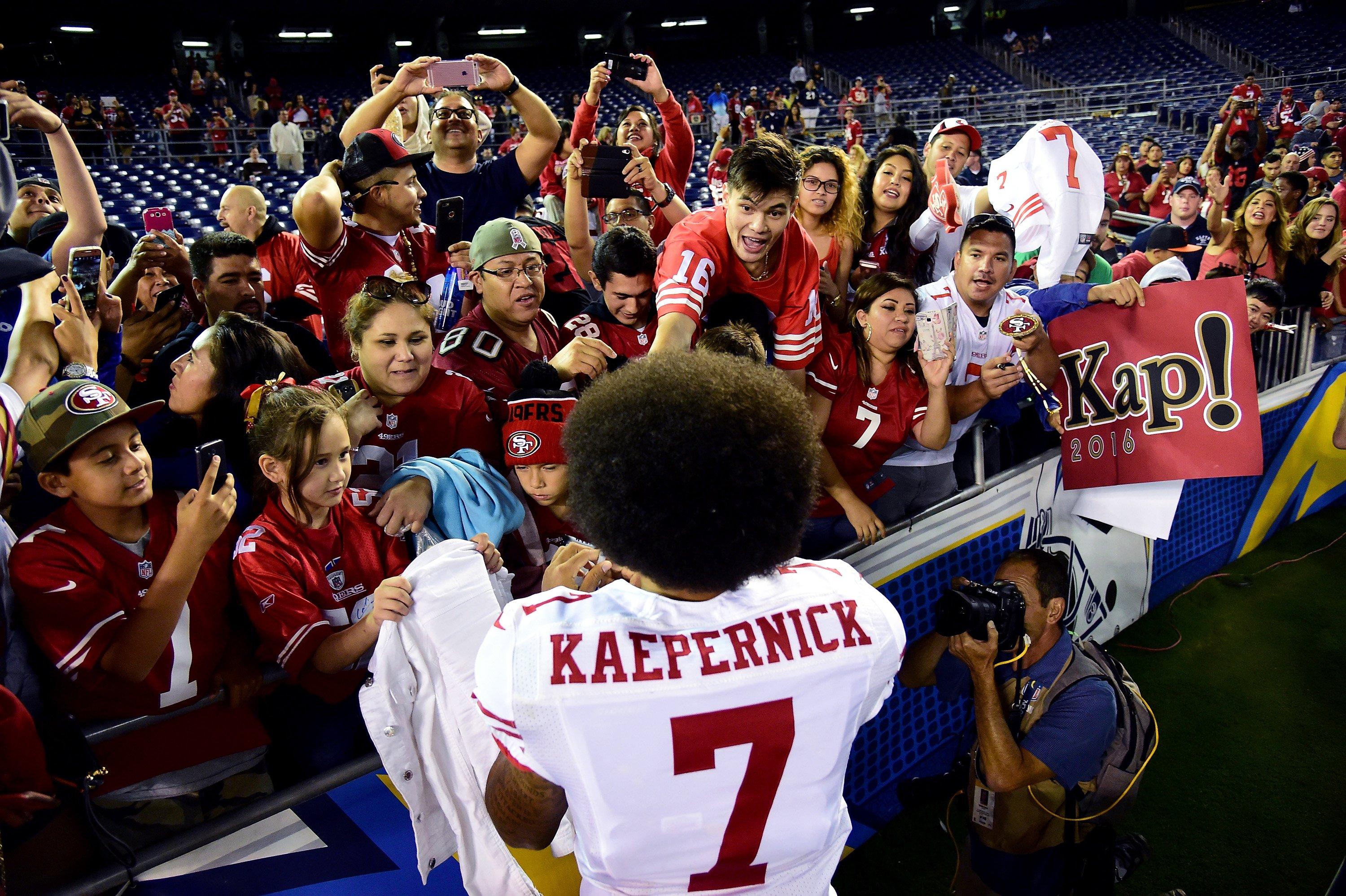 Colin Kaepernick of the San Francisco 49ers signs autographs for fans after a 31-21 win over the San Diego Chargers during a preseason game at Qualcomm Stadium on Sept. 1, 2016 in San Diego.