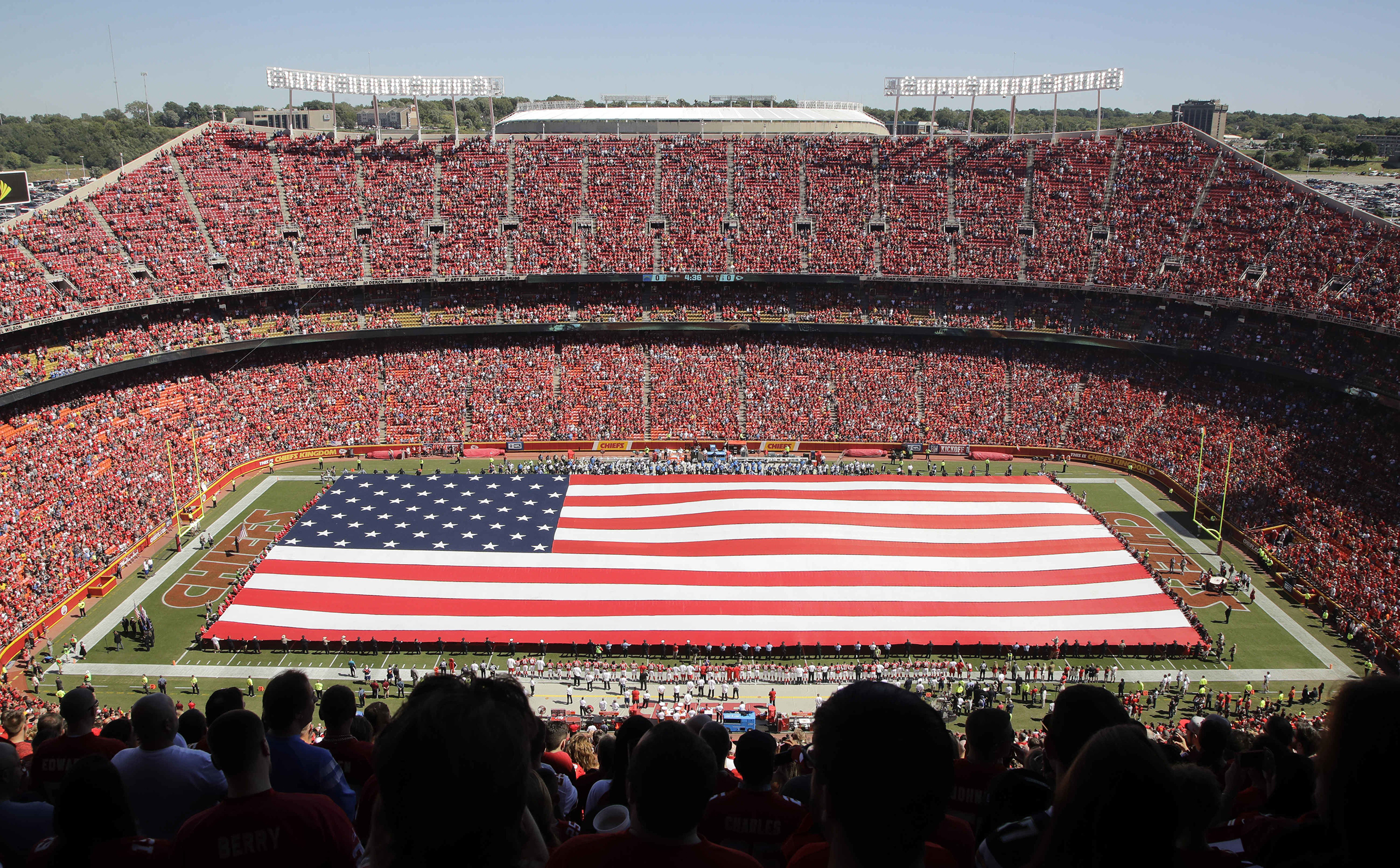 A giant flag is spread over the field at Arrowhead Stadium to commemorate Sept. 11, before an NFL football game between the Kansas City Chiefs and the San Diego Chargers in Kansas City, Missouri, Sept. 11, 2016.