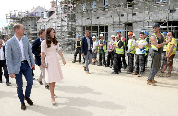 Prince William, Duke of Cambridge and Catherine, Duchess of Cambridge share a joke with construction workers as they visit Nansledan, a 218-hectare site that will provide future business and housing for the local area on September 1, 2016 in Newquay, United Kingdom.