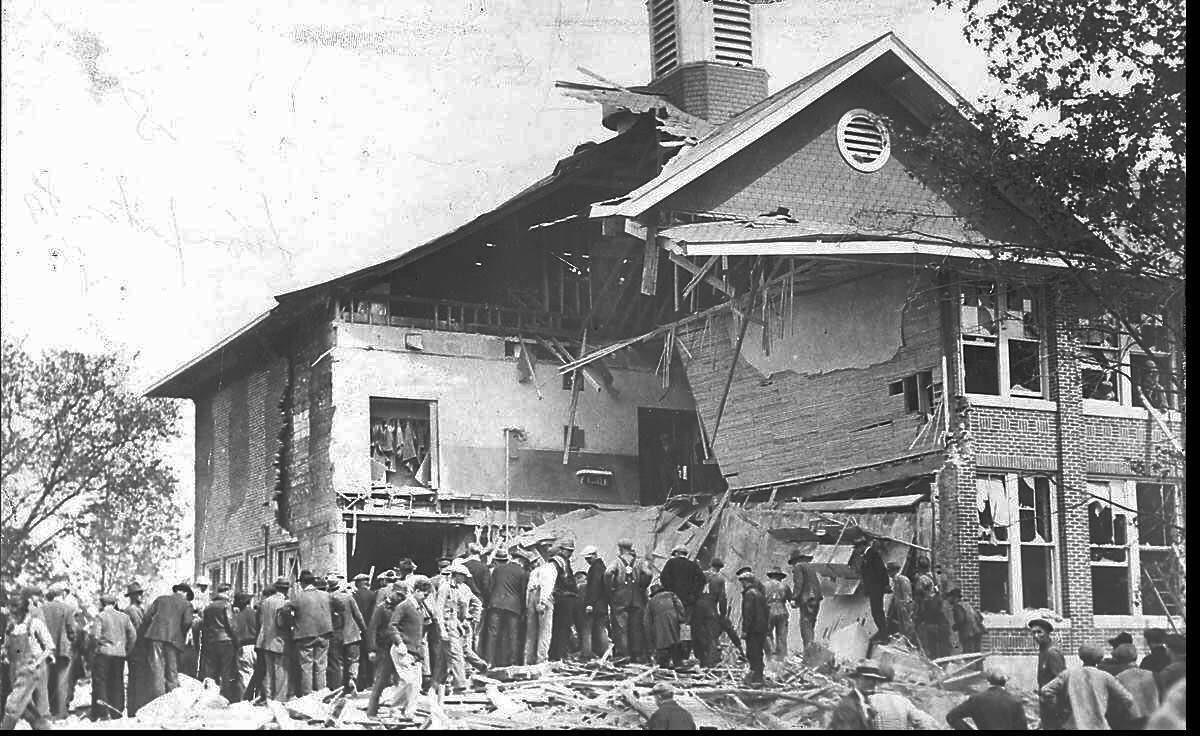 Residents pitch in to find survivors after the Bath (Mich.) Consolidated School was dynamited by school board member Andrew Kehoe on May 18, 1927.