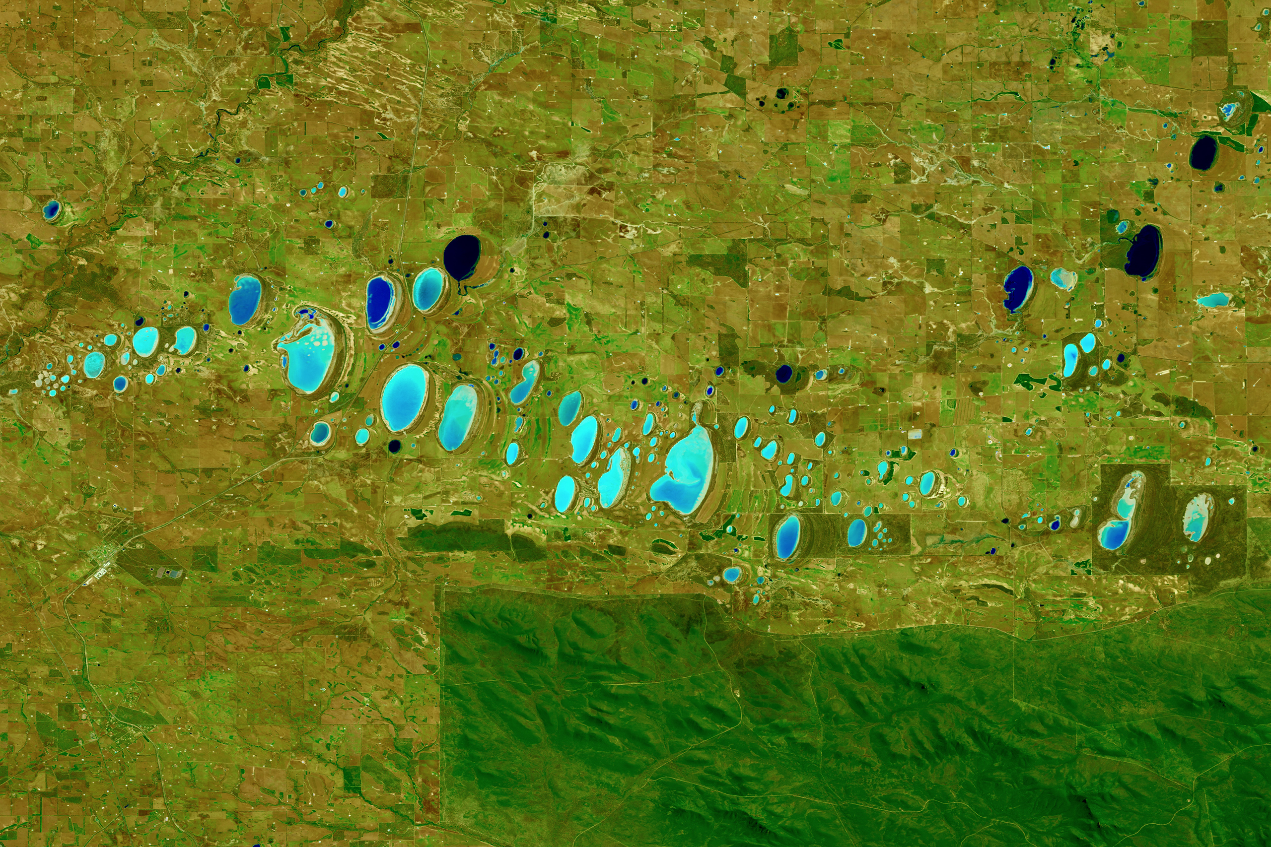 Stirling Range National Park, AustraliaA shortwave infrared image of chain of saline lakes, which vary in color as a result of differing sediments, aquatic and terrestrial plant growth, water chemistry, algae, and hydrology. Shortwave infrared is helpful in differentiating wet earth from dry earth. Oct. 21, 2015.