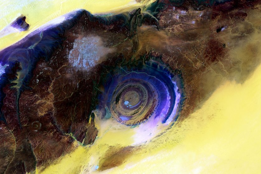 Eye of the Sahara, Mauritania Scientists blended visible and infrared wavelengths to enhance the visibility of the different rock layers of this spectacular rock formation on the western edge of the Sahara desert. June 28 and July 5, 2015.