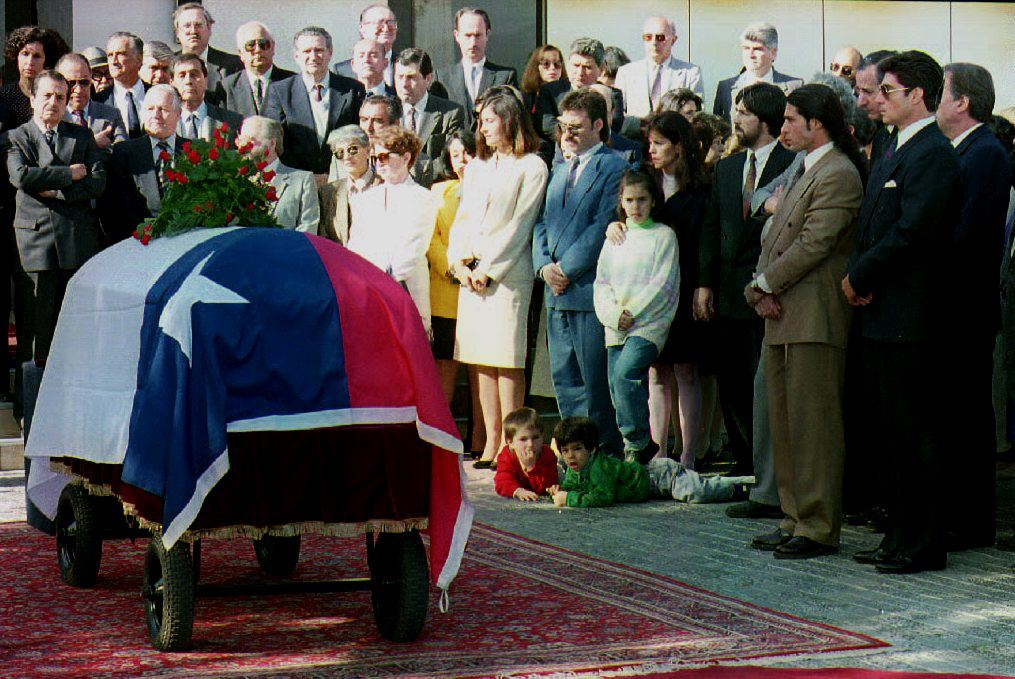 Relatives and friends of former Chilean Minister of Foreign Affairs Orlando Letelier gather next to the coffin bearing his remains Nov. 4, 1992. Letelier's body arrived from Venezuela, where he was buried after he was killed by a car bomb Sept. 16, 1976 in Washington, D.C.