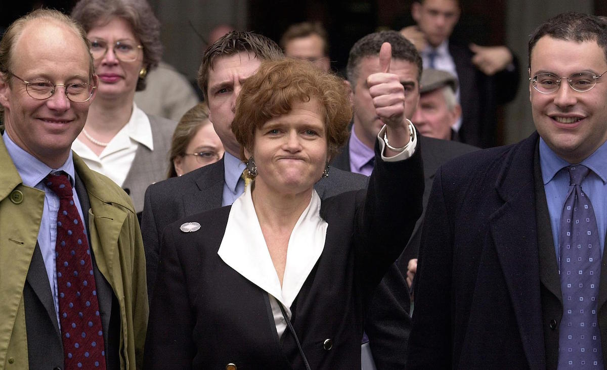 U.S. academic Deborah Lipstadt (C) exults April 11, 2000, the High Court in London after winning a libel case brought against her and Penguin publications by British revisionist historian David Irving.