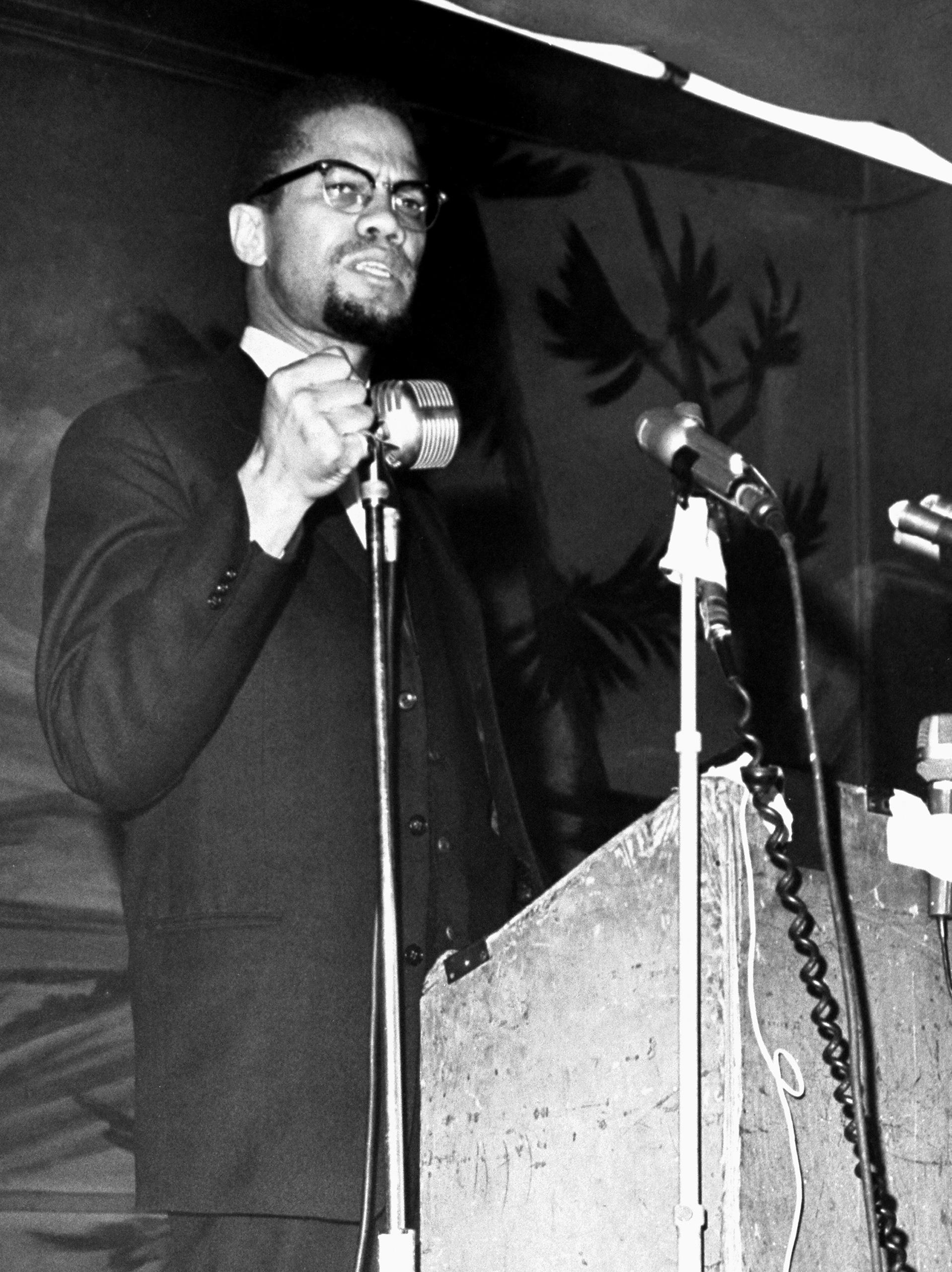 Malcolm X speaks at the Audubon Ballroom in Harlem on Feb. 15, 1965.