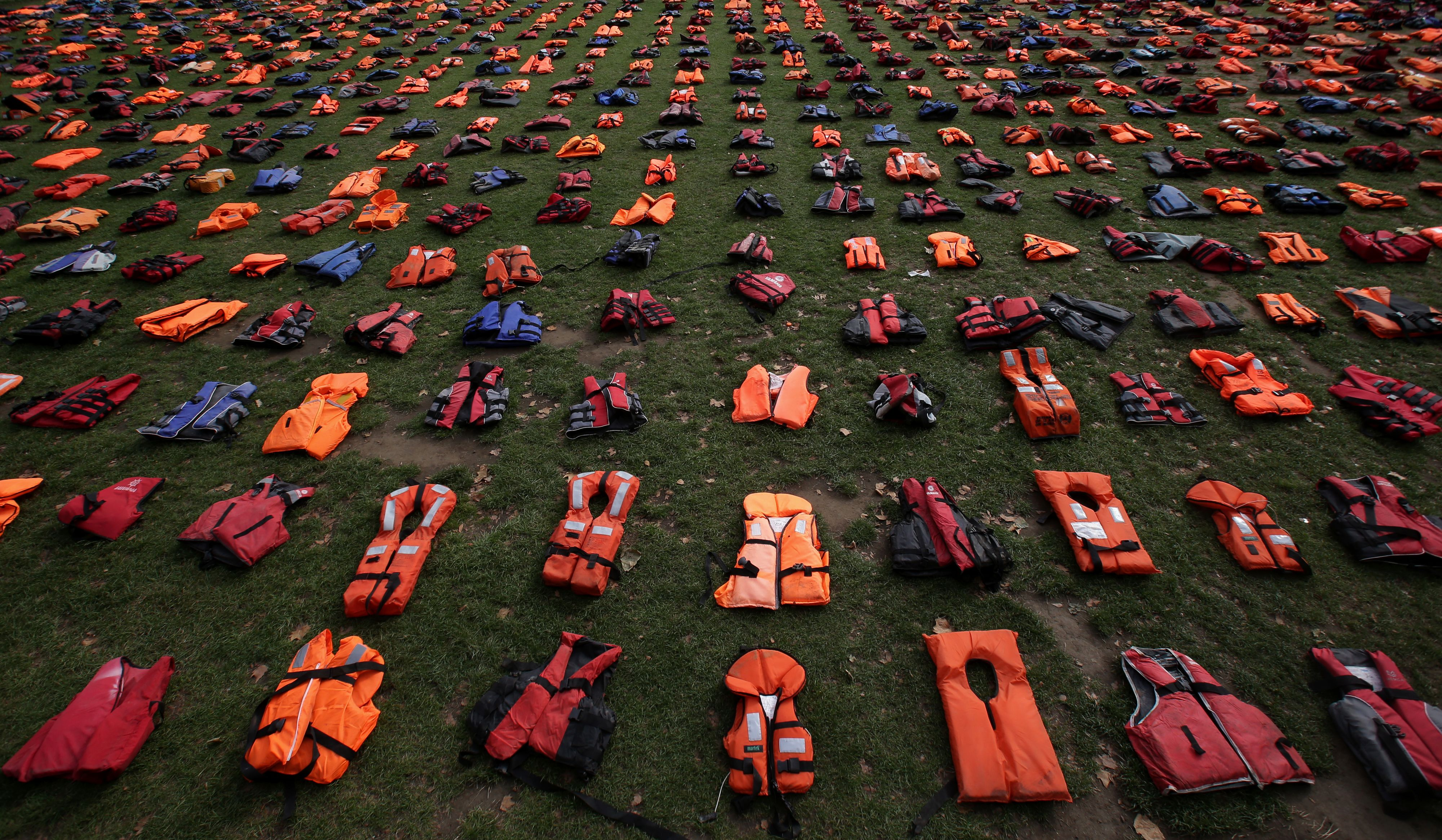 2,500 lifejackets, worn by refugees during crossings from Turkey to the Greek island of Chios, are displayed on Parliament Square, opposite the Houses of Parliament, in central London, on September 19, 2016, during a photcall to highlight the number of refugees that have died trying to reach Europe since 2015.