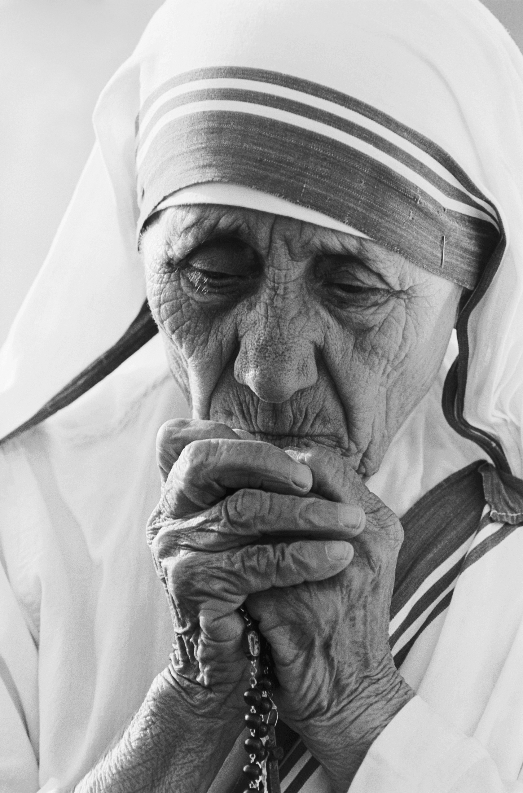 Nobel Peace Prize winner Mother Teresa prays in 1988, during the dedication ceremonies at her 400th worldwide mission to care for the poor in Tijuana, Mexico. The Tijuana mission will shelter the homeless, the terminally ill and unwed mothers.