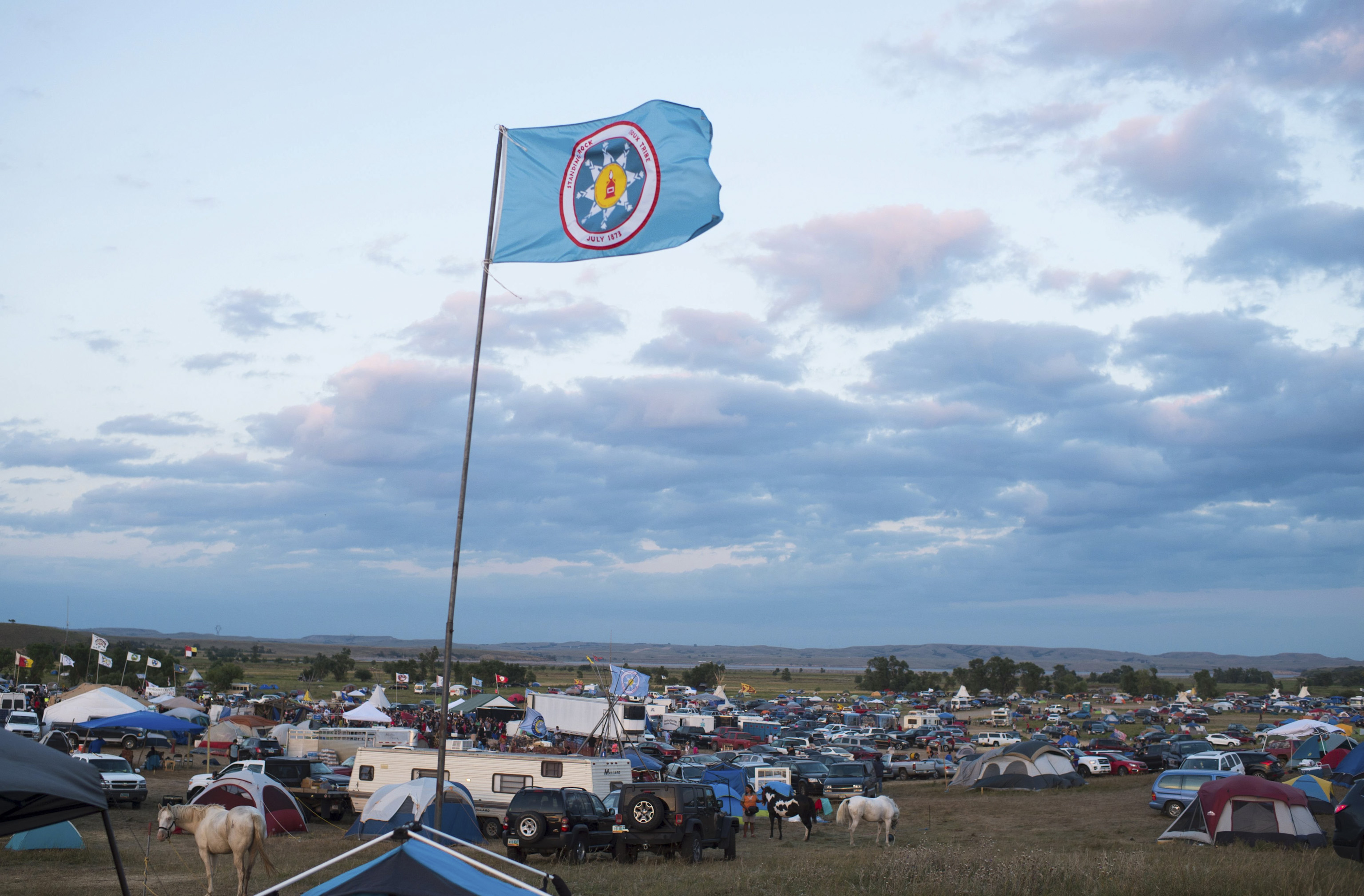 A Standing Rock Sioux flag flies over a protest encampment near Cannon Ball, North Dakota, on Sept. 3, 2016.