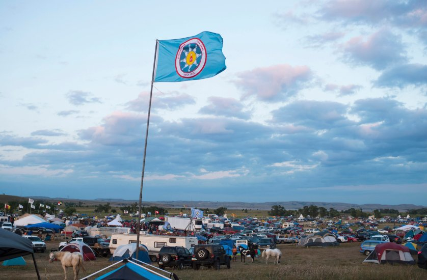 A Standing Rock Sioux flag flies over a protest encampment near Cannon Ball, North Dakota on Sept. 3, 2016.