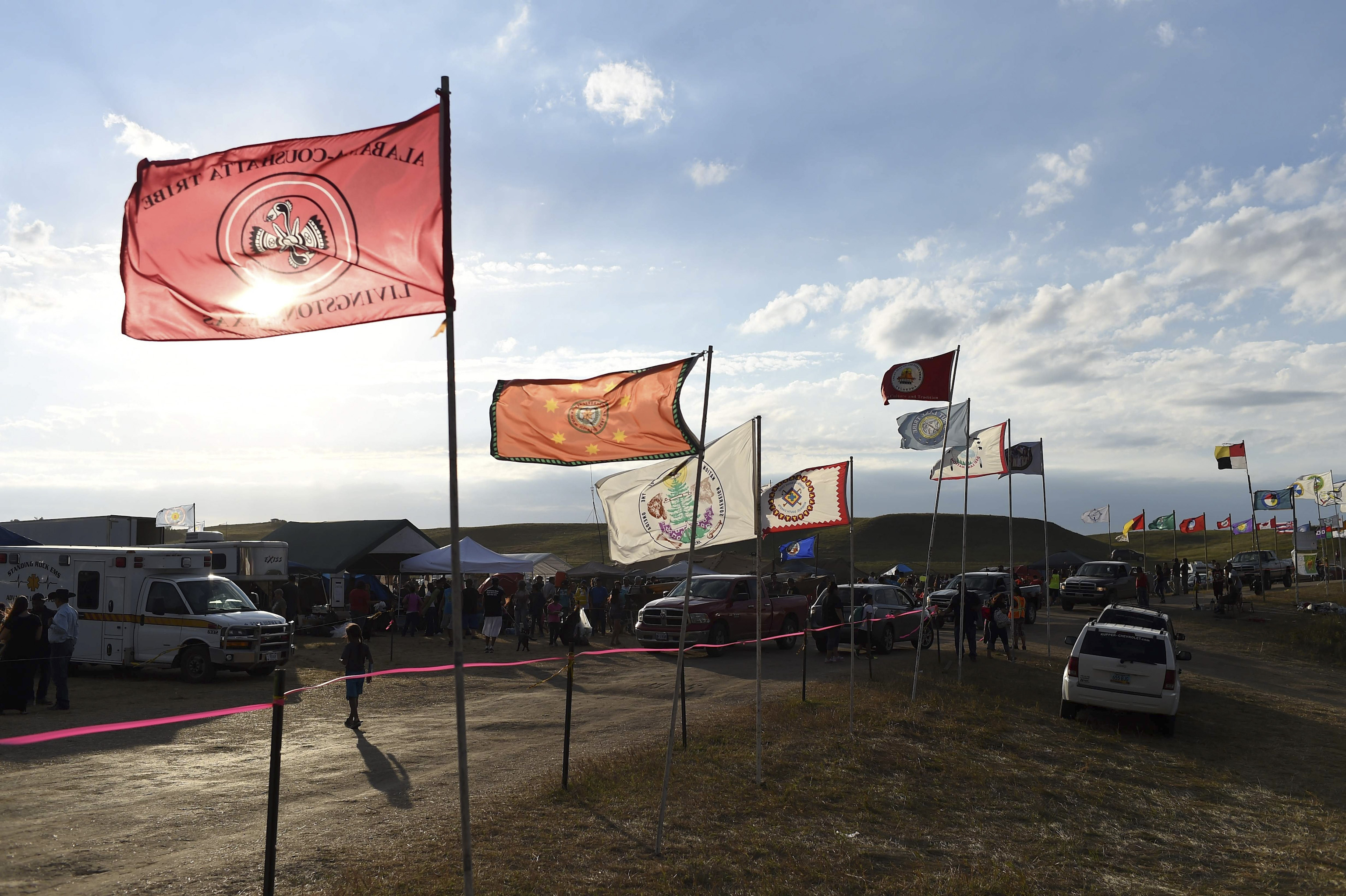 Flags of Native American tribes from across the U.S. and Canada line the entrance to a protest encampment near Cannon Ball, North Dakota, on Sept. 3, 2016.