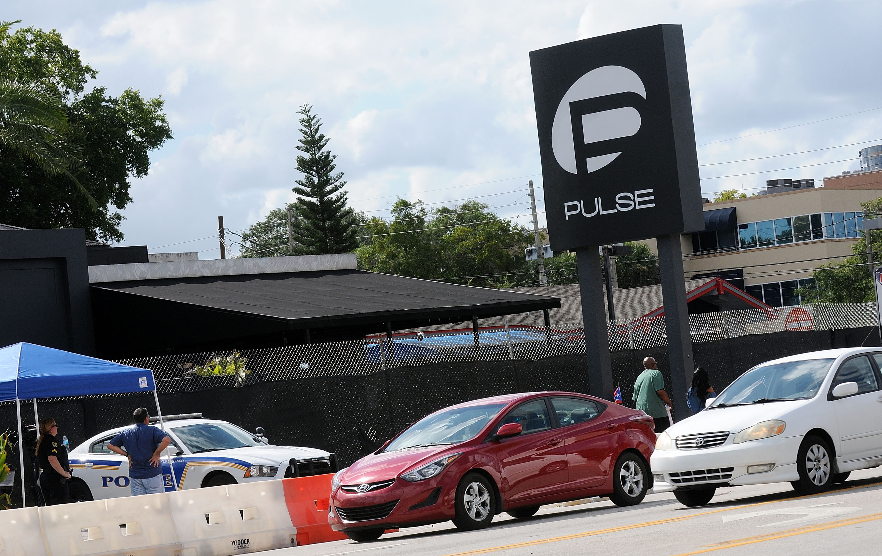 Vehicles cross in front of the Pulse Nightclub on June 21, 2016 in Orlando, Florida.