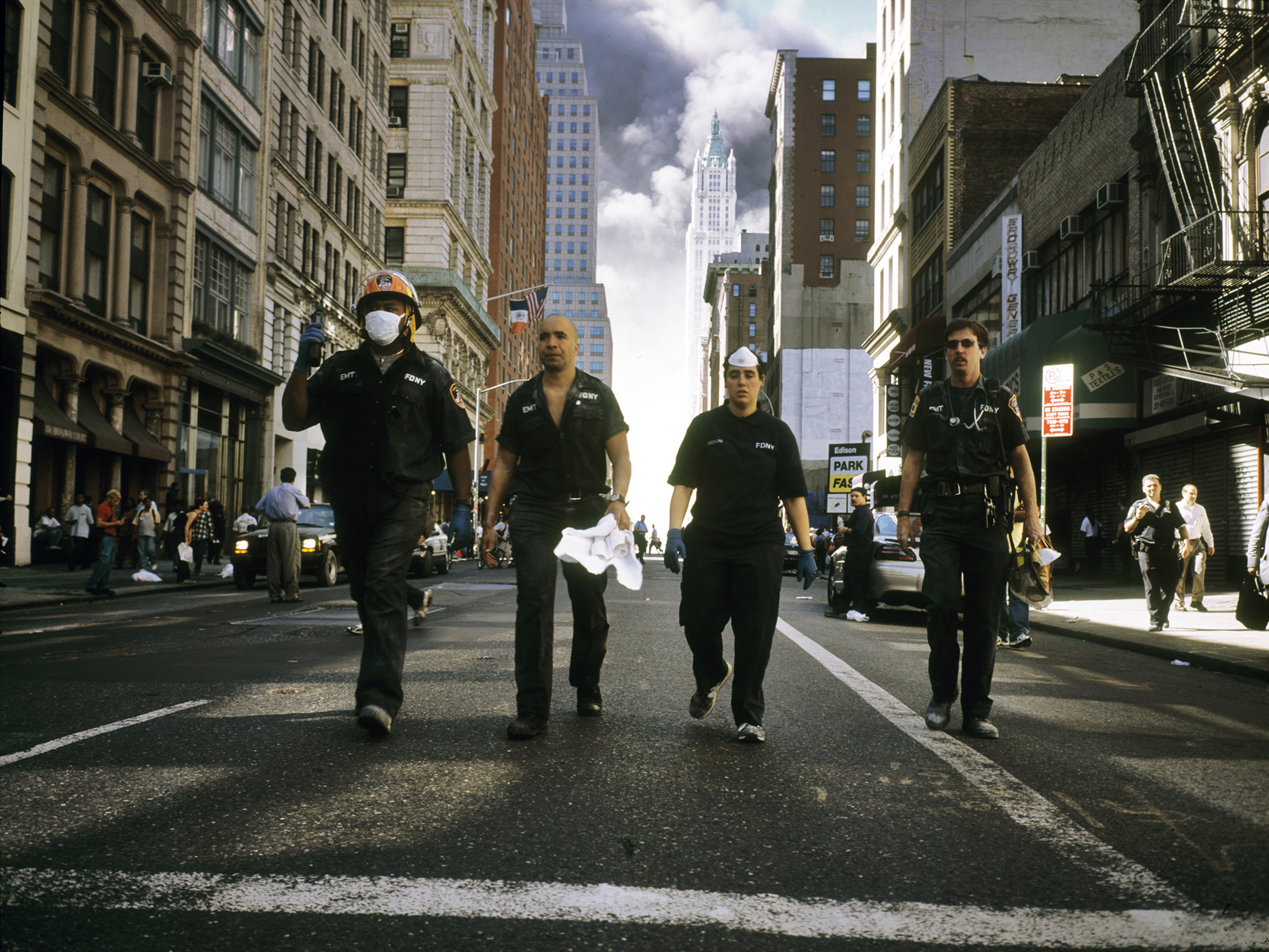 Police officers walking north on Broadway just after the collapse of the World Trade Center, on Sept. 11, 2001.