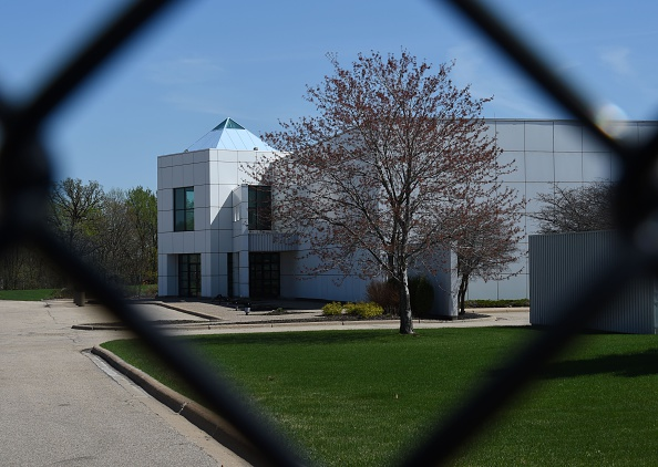 The entrance of the Paisley Park compound of music legend Prince is seen through a fence in Minneapolis, Minnesota, on April 22, 2016.
