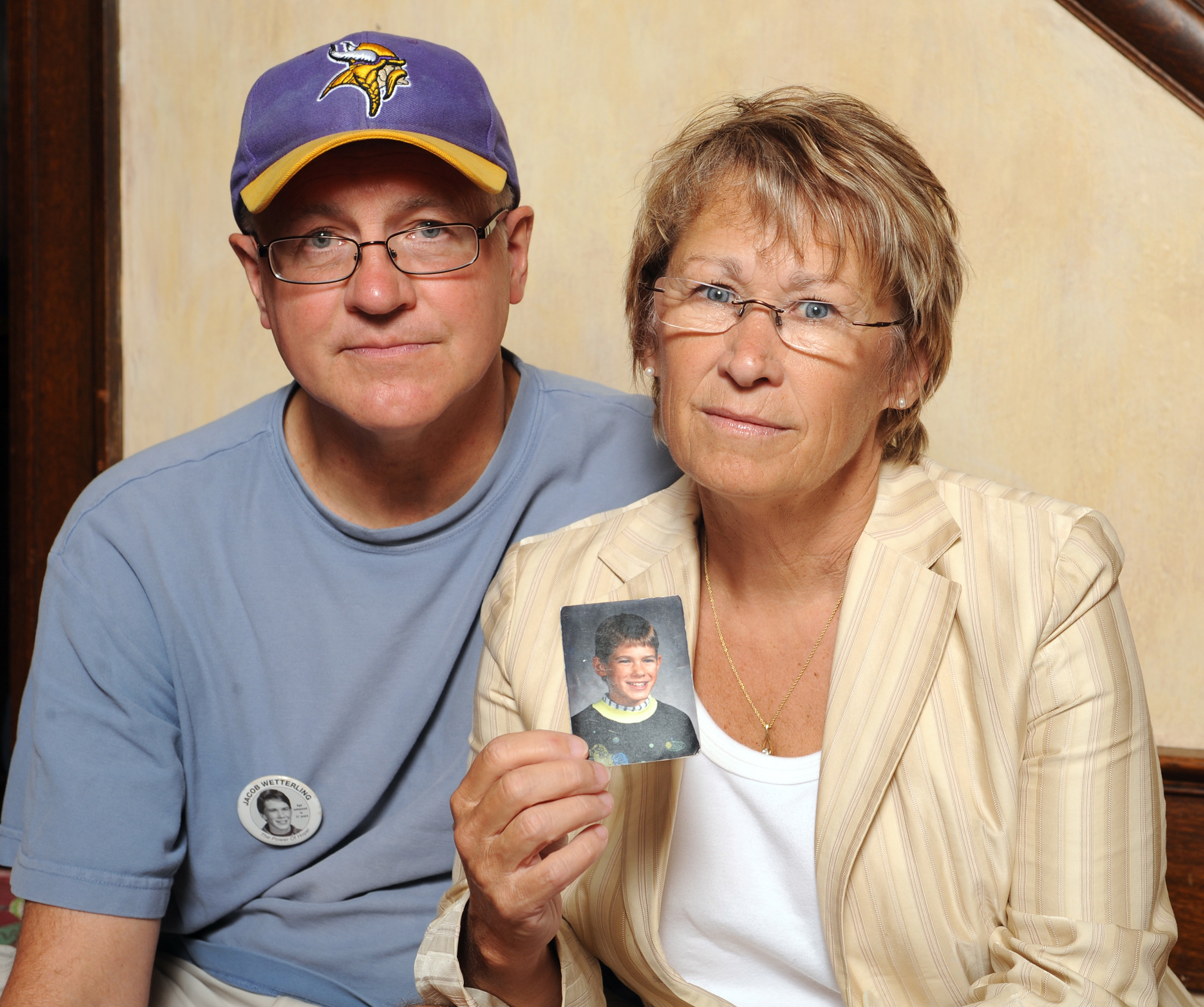 Patty and Jerry Wetterling show a photo of their son Jacob Wetterling, who was abducted in October of 1989 in St. Joseph, Minnesota, Aug. 28, 2009.