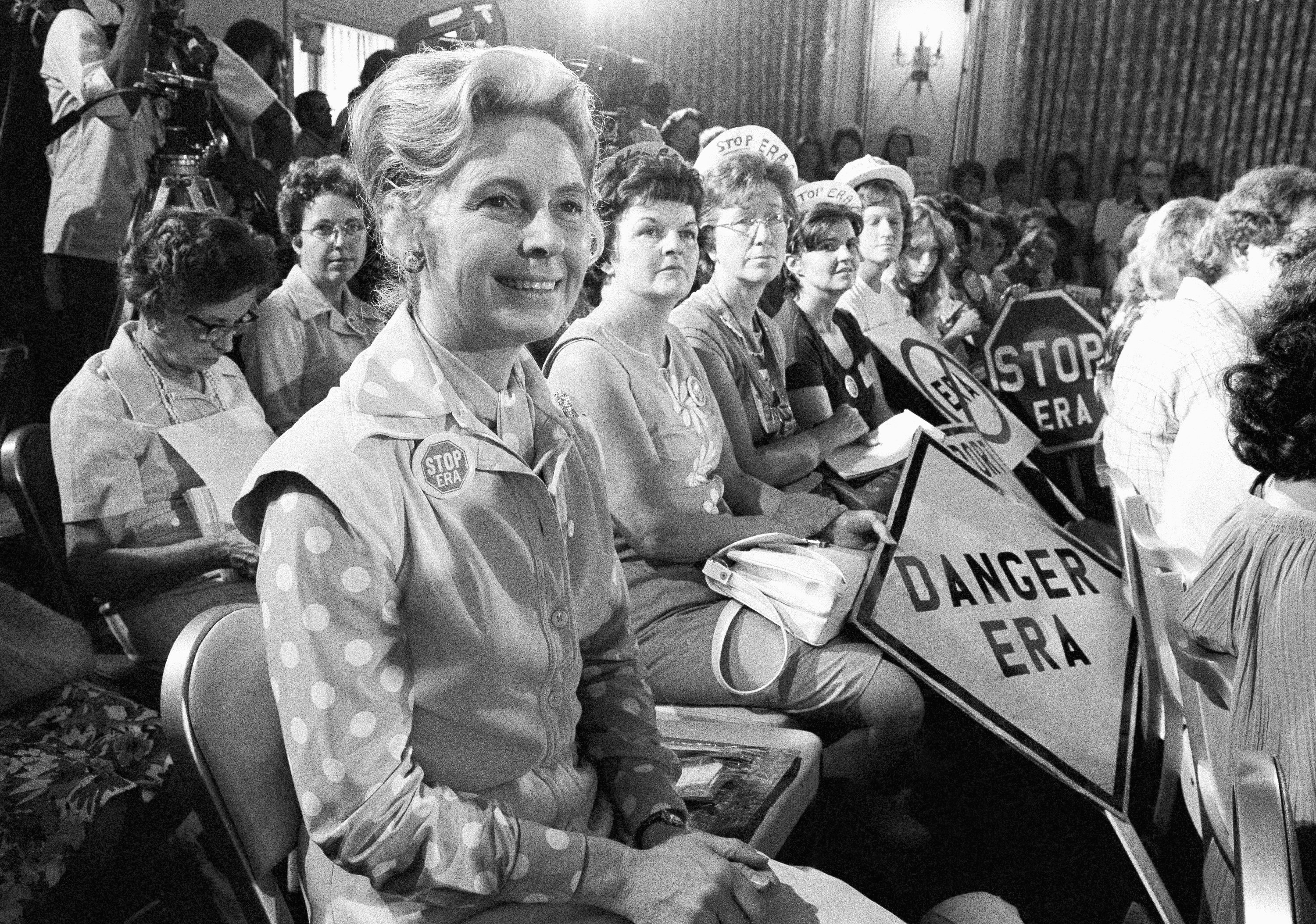 Phyllis Schlafly, left, sit with women opposed to the Equal Rights Amendment during a Republican platform subcommittee hearing in Kansas City, Mo, Aug. 10, 1976.