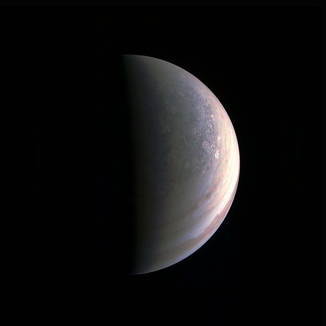 The JunoCam instrument obtained this view of Jupiter on August 27, about two hours before closest approach, when the spacecraft was 120,000 miles (195,000 kilometers) away from the giant planet (i.e., for Jupiter's center).